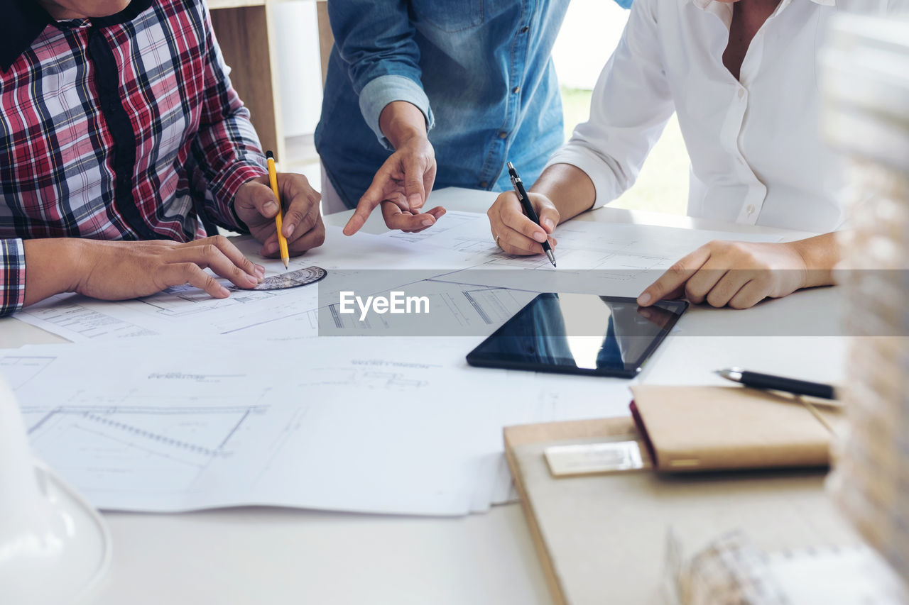 Close-Up Of Business People Working In Office