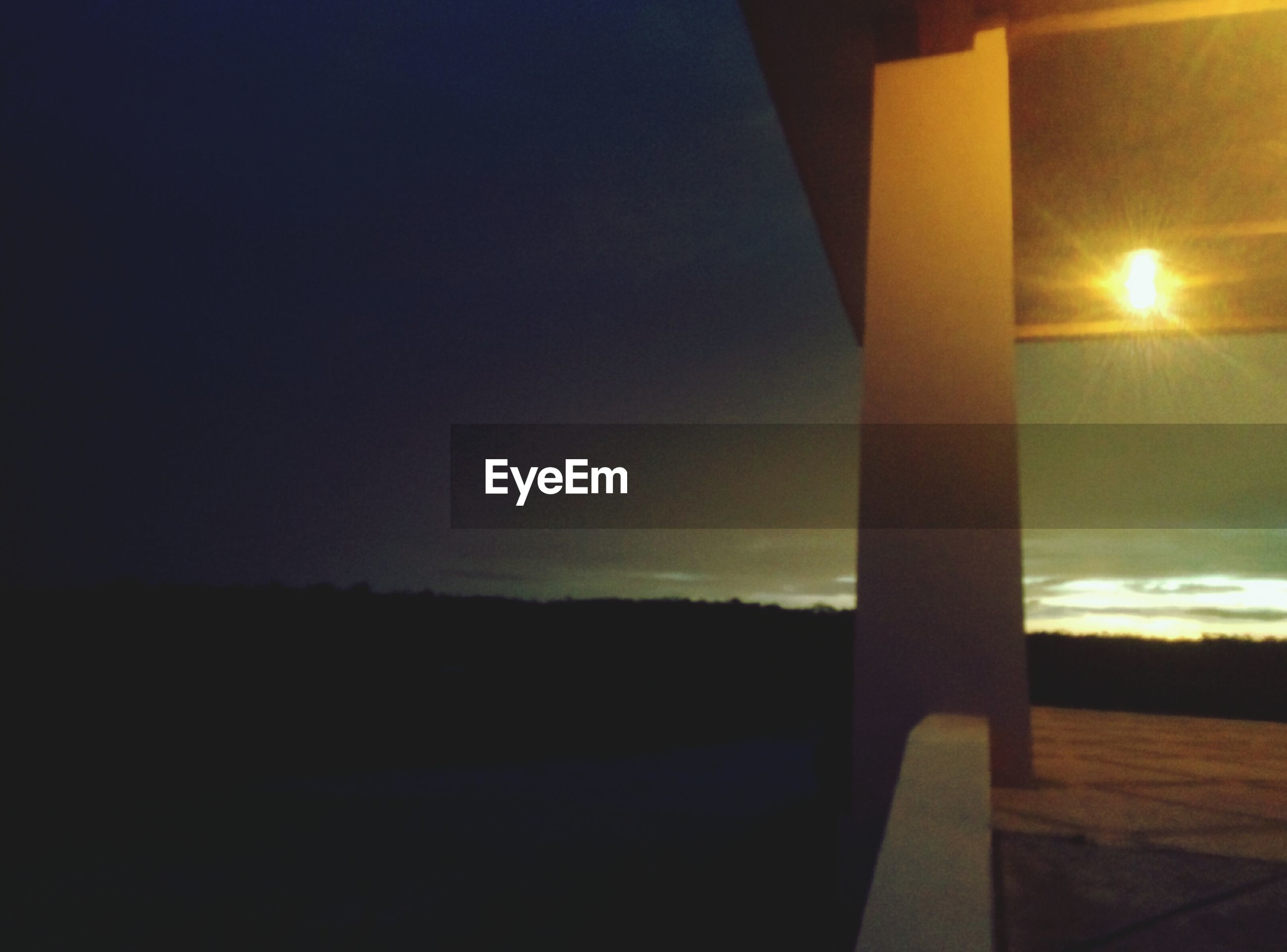sunset, sun, silhouette, sunlight, sky, lens flare, tranquility, sunbeam, nature, clear sky, tranquil scene, no people, beauty in nature, scenics, dusk, street light, dark, outdoors, built structure, illuminated