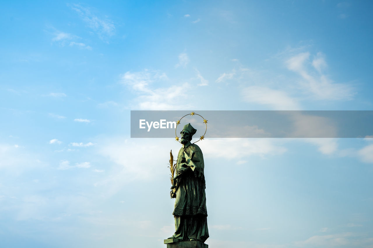 sky, cloud - sky, statue, sculpture, human representation, art and craft, representation, creativity, day, nature, low angle view, no people, female likeness, male likeness, outdoors, angel, craft, sunlight, freedom, religion