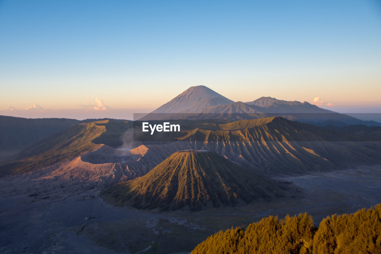 mountain, beauty in nature, scenics - nature, sky, tranquil scene, tranquility, volcano, non-urban scene, landscape, sunset, environment, idyllic, no people, nature, mountain range, geology, physical geography, travel destinations, clear sky, land, outdoors, volcanic crater, mountain peak