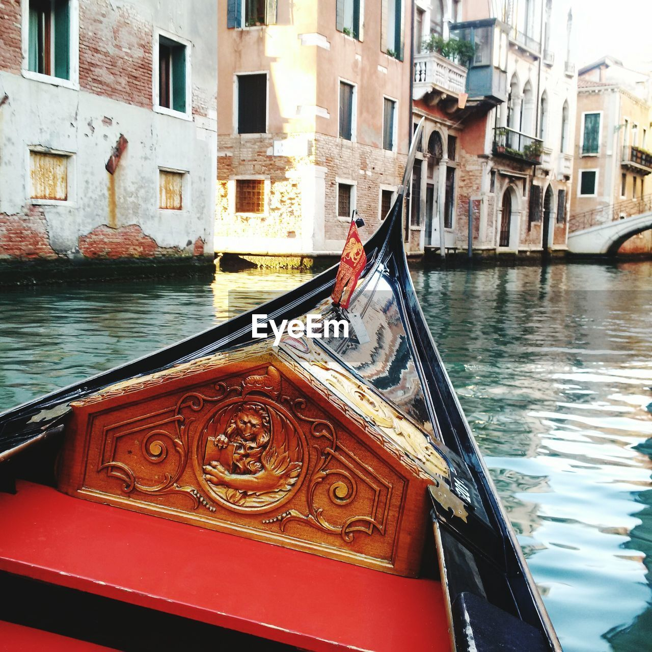 architecture, building exterior, built structure, water, canal, nautical vessel, gondola, transportation, day, outdoors, real people, gondola - traditional boat, one person, city