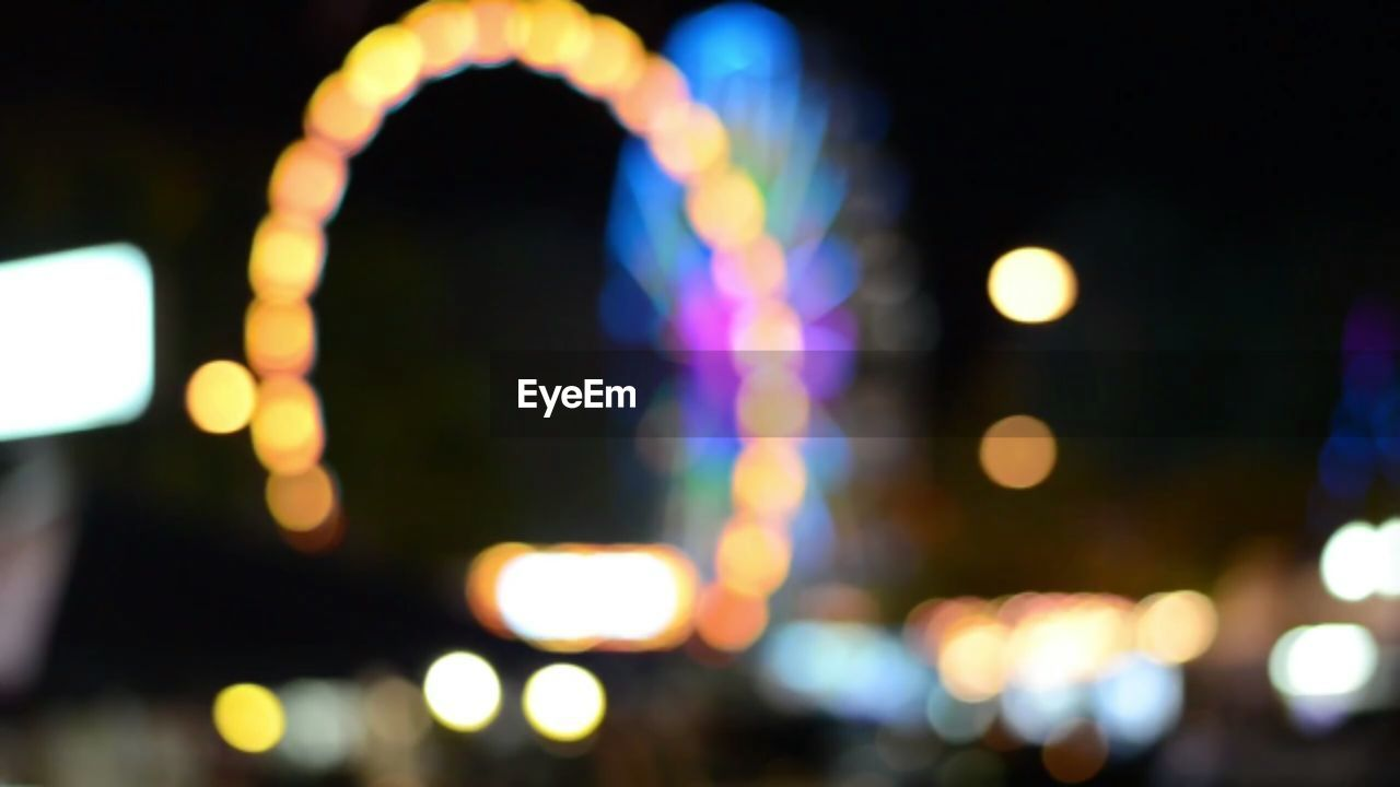 illuminated, night, defocused, focus on foreground, outdoors, city, no people, travel destinations, architecture, close-up, building exterior, cityscape, sky