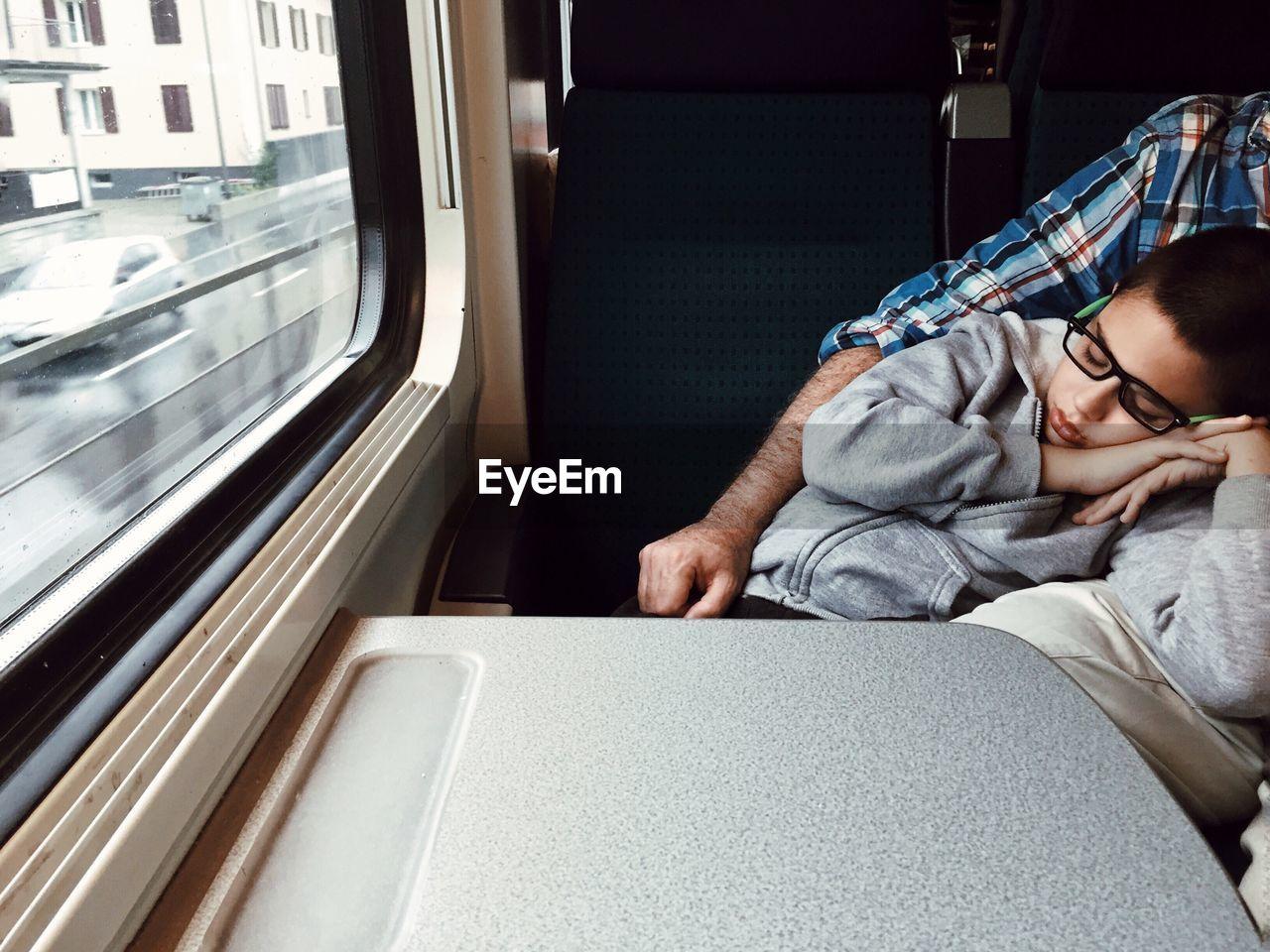 Close-Up Of Boy Sleeping On Train