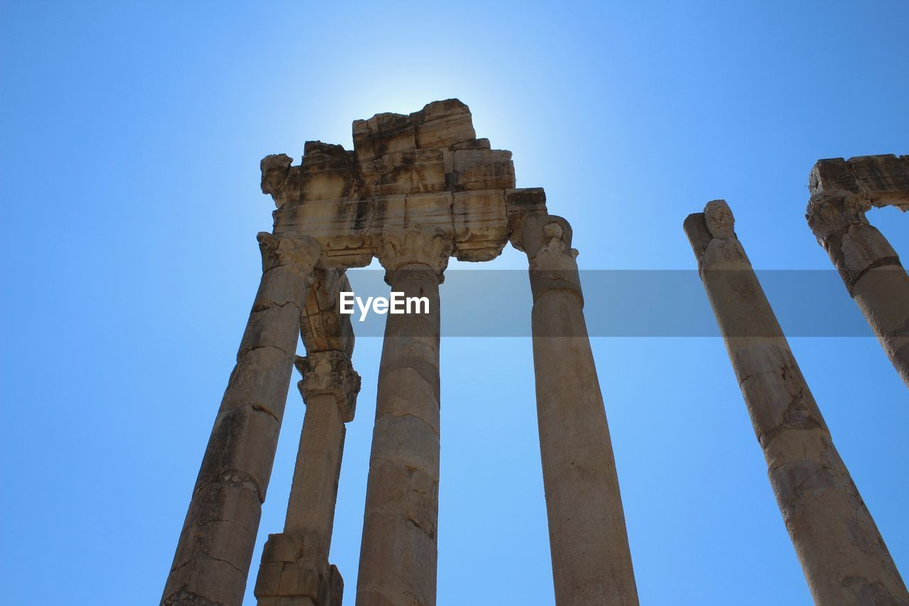 history, the past, sky, ancient, architecture, old ruin, built structure, ancient civilization, clear sky, ruined, low angle view, damaged, architectural column, nature, travel destinations, day, archaeology, tourism, bad condition, travel, no people, outdoors, deterioration