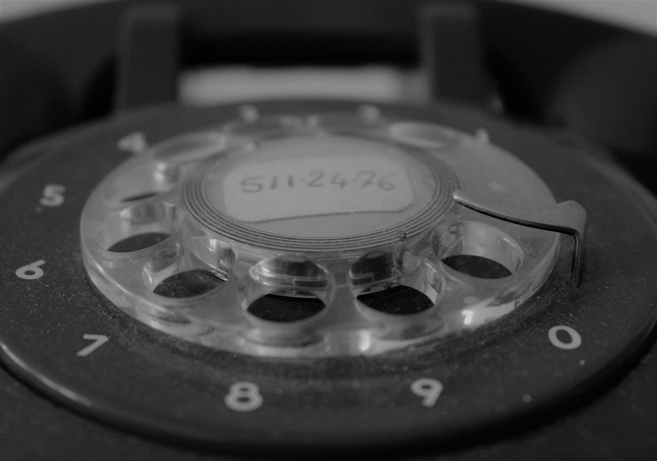 close-up, indoors, no people, number, technology, still life, selective focus, text, communication, metal, focus on foreground, retro styled, shape, control, table, machinery, equipment, connection, time