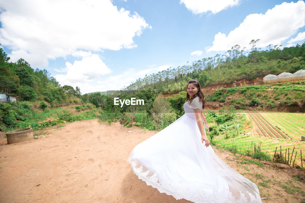real people, wedding, bride, full length, young adult, sky, young women, one person, standing, nature, day, wedding dress, outdoors, tree, lifestyles, women, happiness, smiling, beauty in nature, beautiful woman, portrait, groom