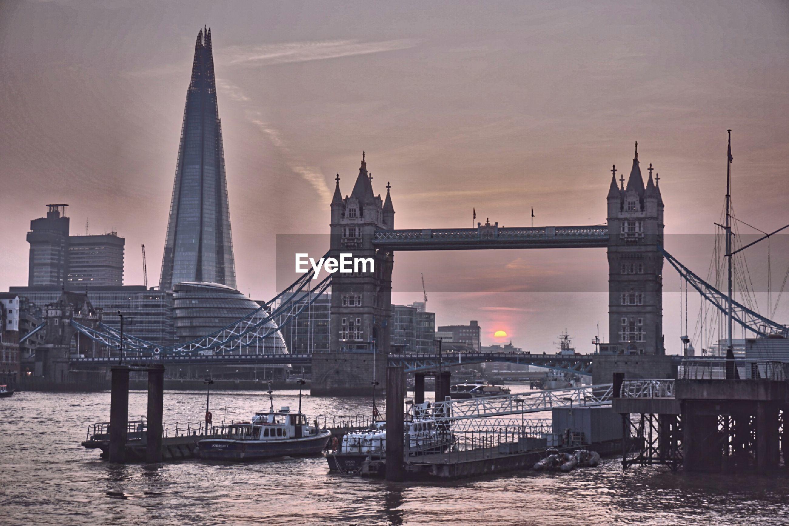 Bridge across river at sunset