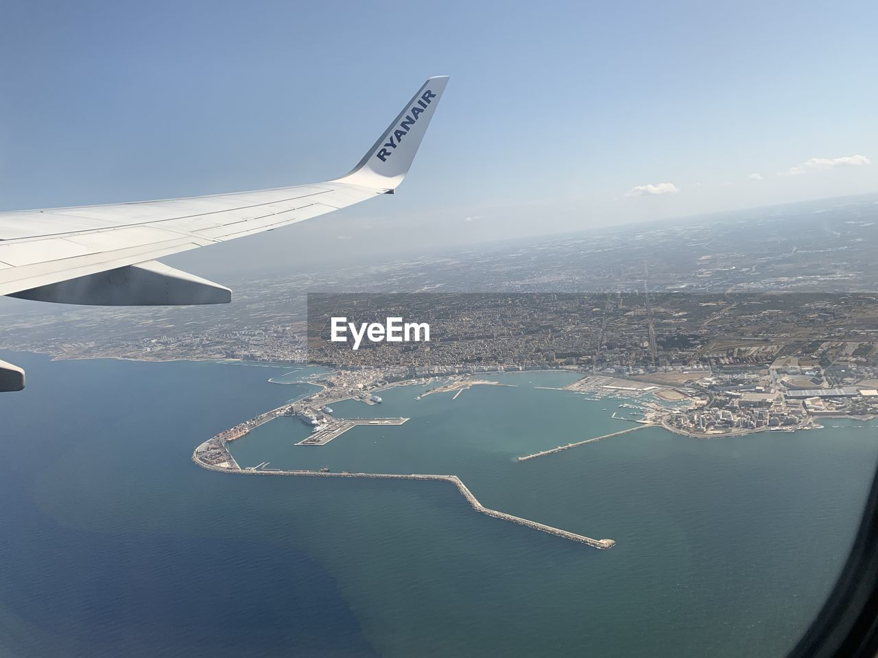 airplane, air vehicle, aerial view, water, transportation, flying, sky, mode of transportation, mid-air, nature, aircraft wing, building exterior, sea, architecture, travel, built structure, no people, scenics - nature, city, outdoors, cityscape