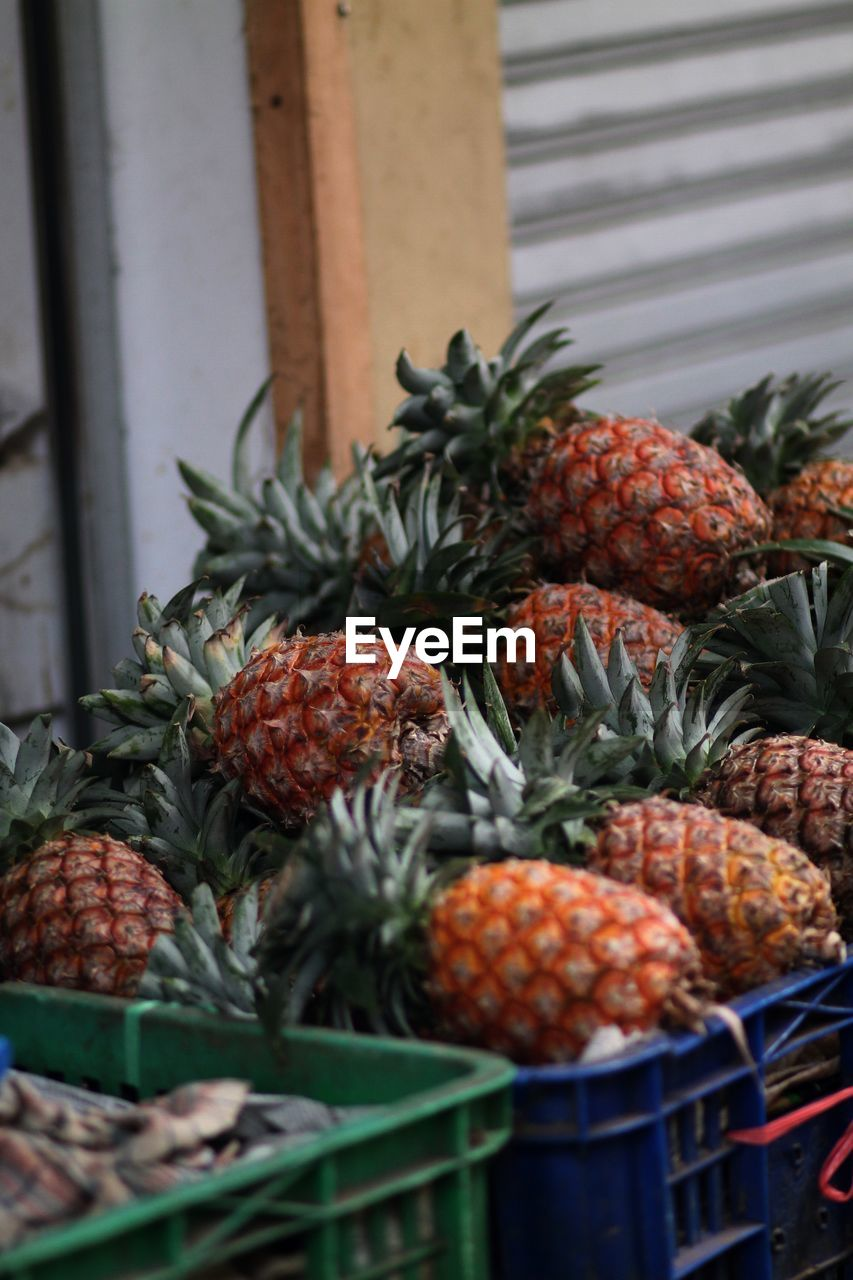 food and drink, food, fruit, healthy eating, freshness, wellbeing, no people, container, market, large group of objects, day, tropical fruit, retail, for sale, pineapple, choice, market stall, still life, red, close-up, outdoors, ripe, retail display, lychee, street market