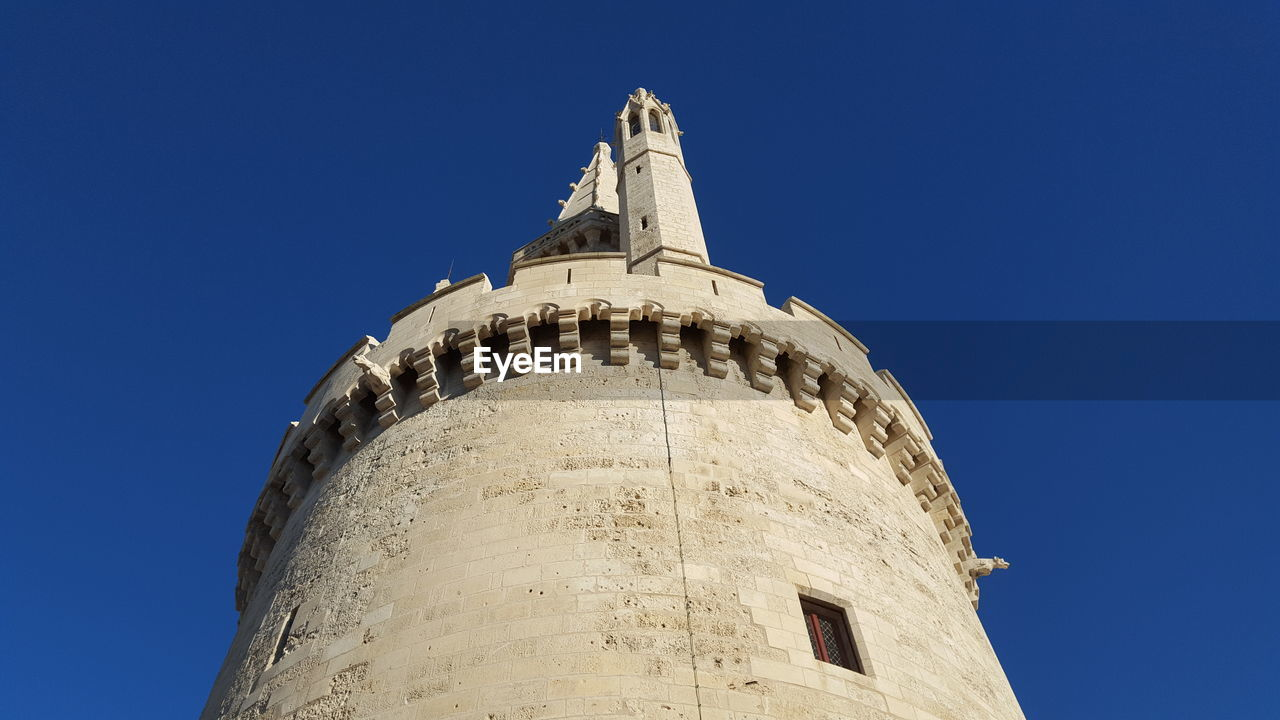 Low Angle View Of Church Tower Against Clear Blue Sky