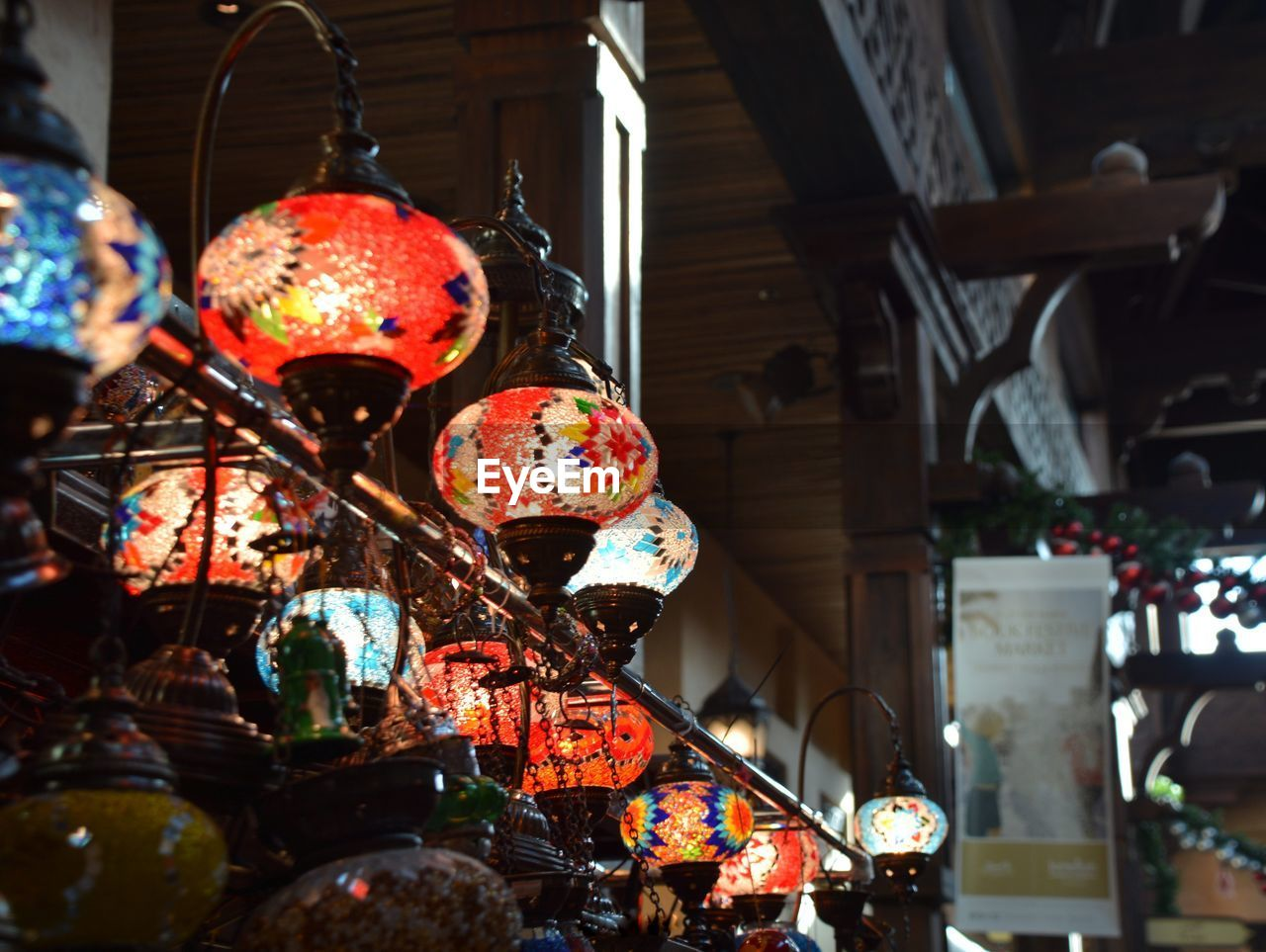 Close-Up Of Illuminated Lanterns Hanging In Store