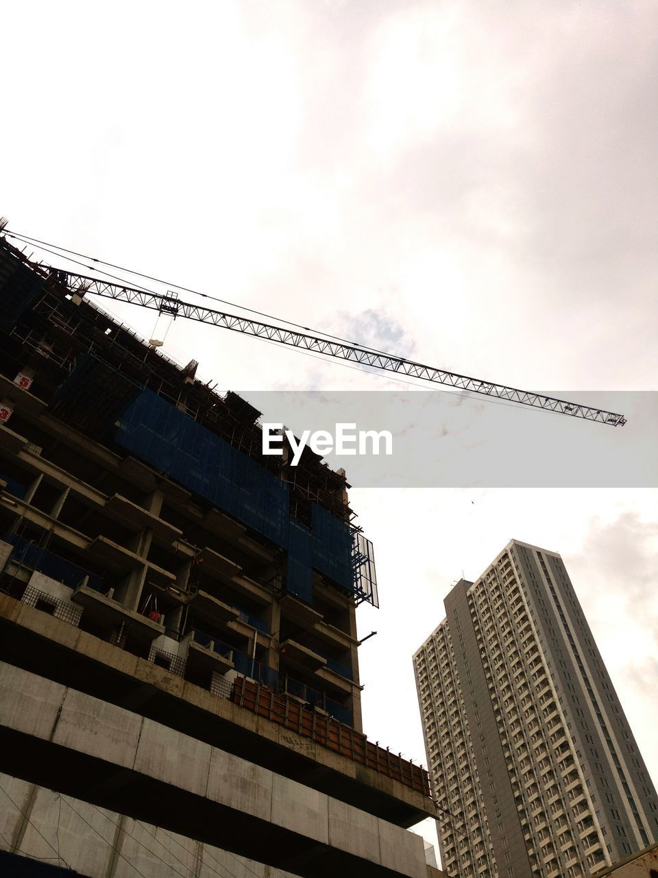 architecture, low angle view, building exterior, built structure, no people, city, skyscraper, day, outdoors, sky, modern