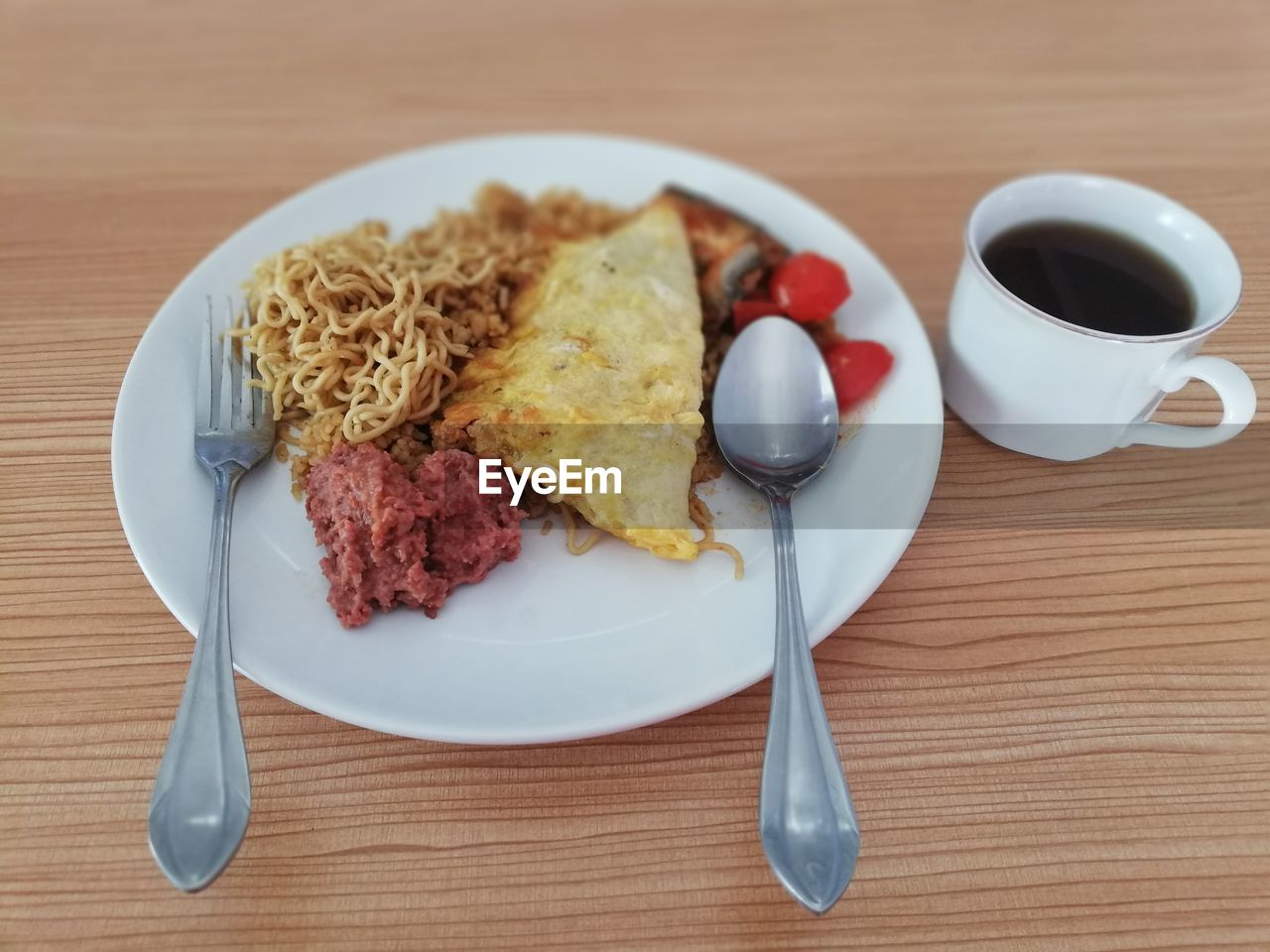 food and drink, eating utensil, food, kitchen utensil, table, plate, ready-to-eat, breakfast, spoon, meal, freshness, cup, indoors, fork, drink, coffee - drink, healthy eating, refreshment, coffee, serving size, no people, table knife, crockery, temptation