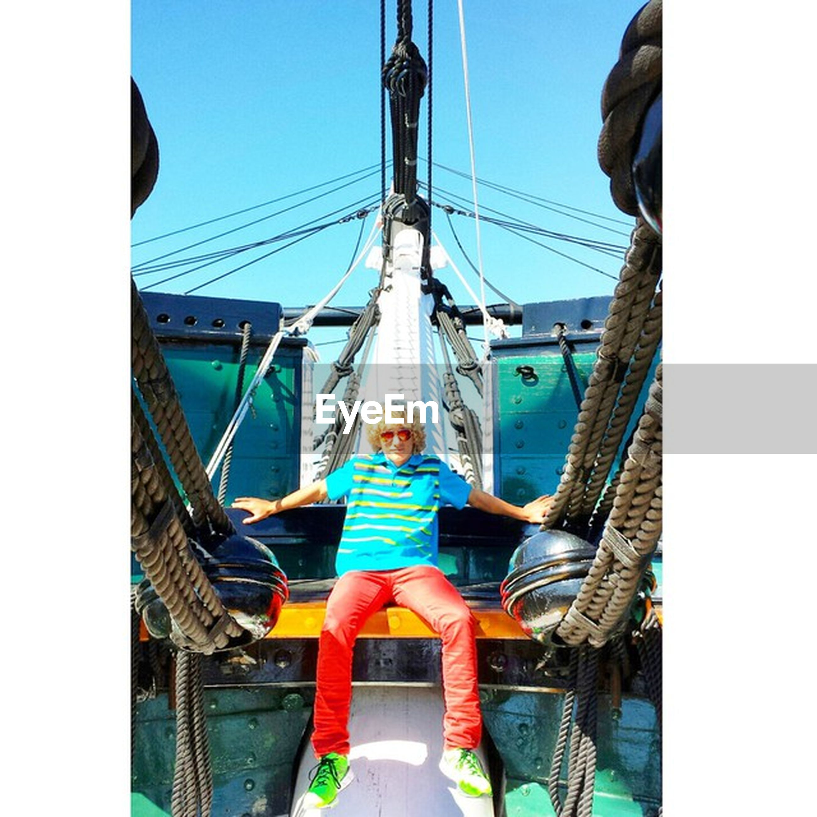 lifestyles, nautical vessel, transportation, leisure activity, casual clothing, built structure, men, travel, rear view, architecture, boat, full length, standing, sky, mode of transport, bridge - man made structure, tourism, connection