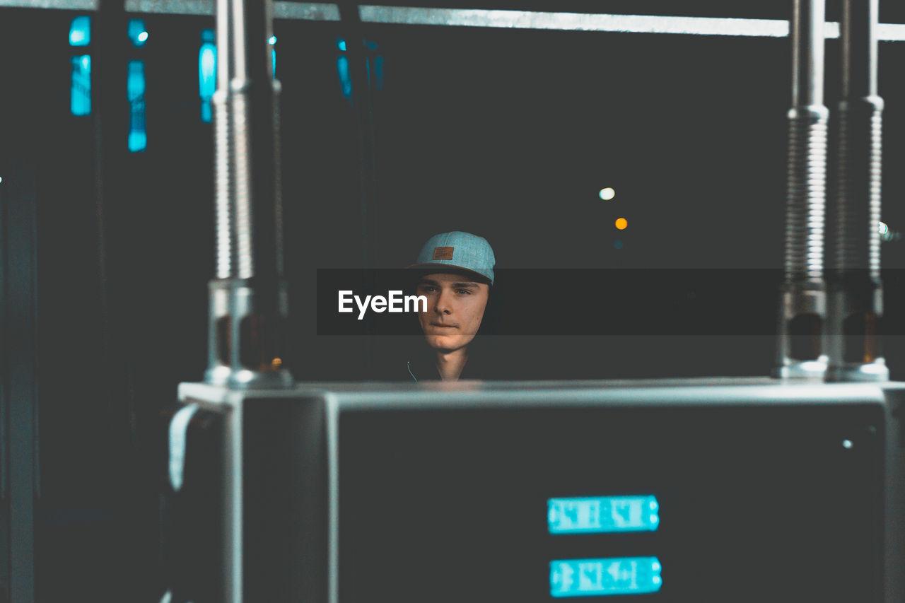 Man Wearing Cap In Darkroom