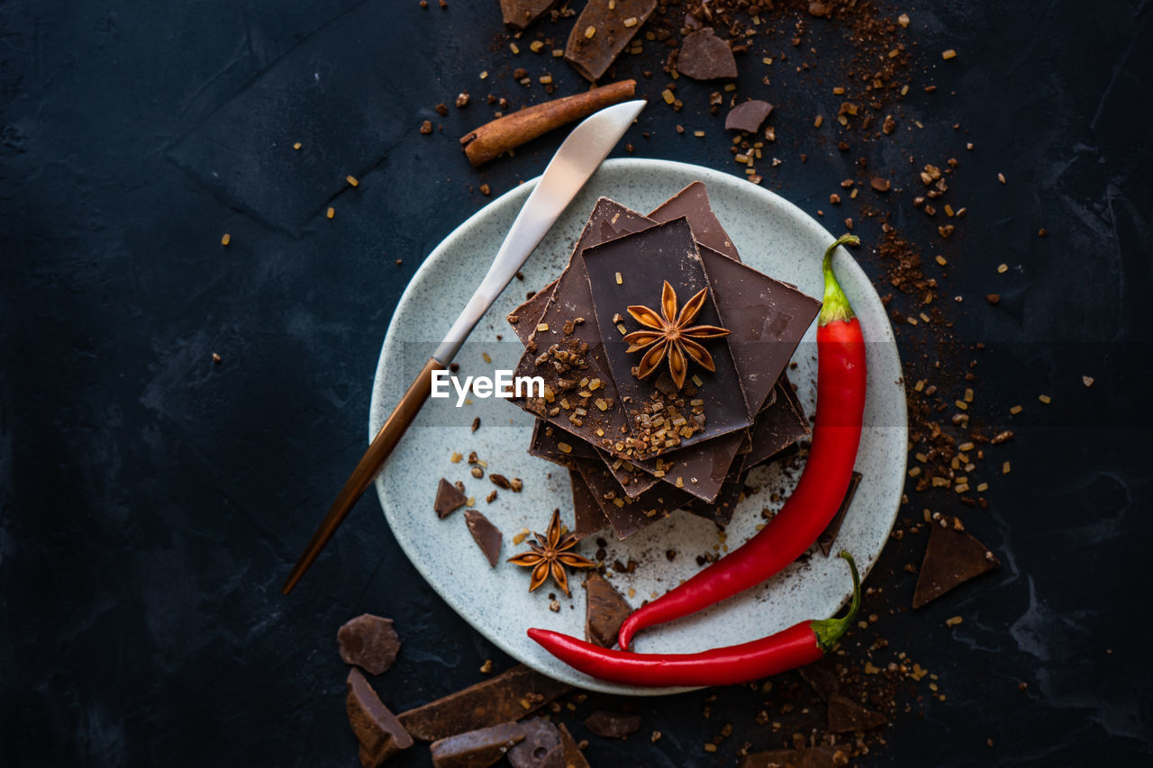 star anise, food and drink, food, spice, cinnamon, high angle view, christmas, celebration, table, no people, directly above, holiday, christmas decoration, still life, close-up, freshness, star shape, indoors, sweet food, gingerbread cookie, temptation, christmas ornament
