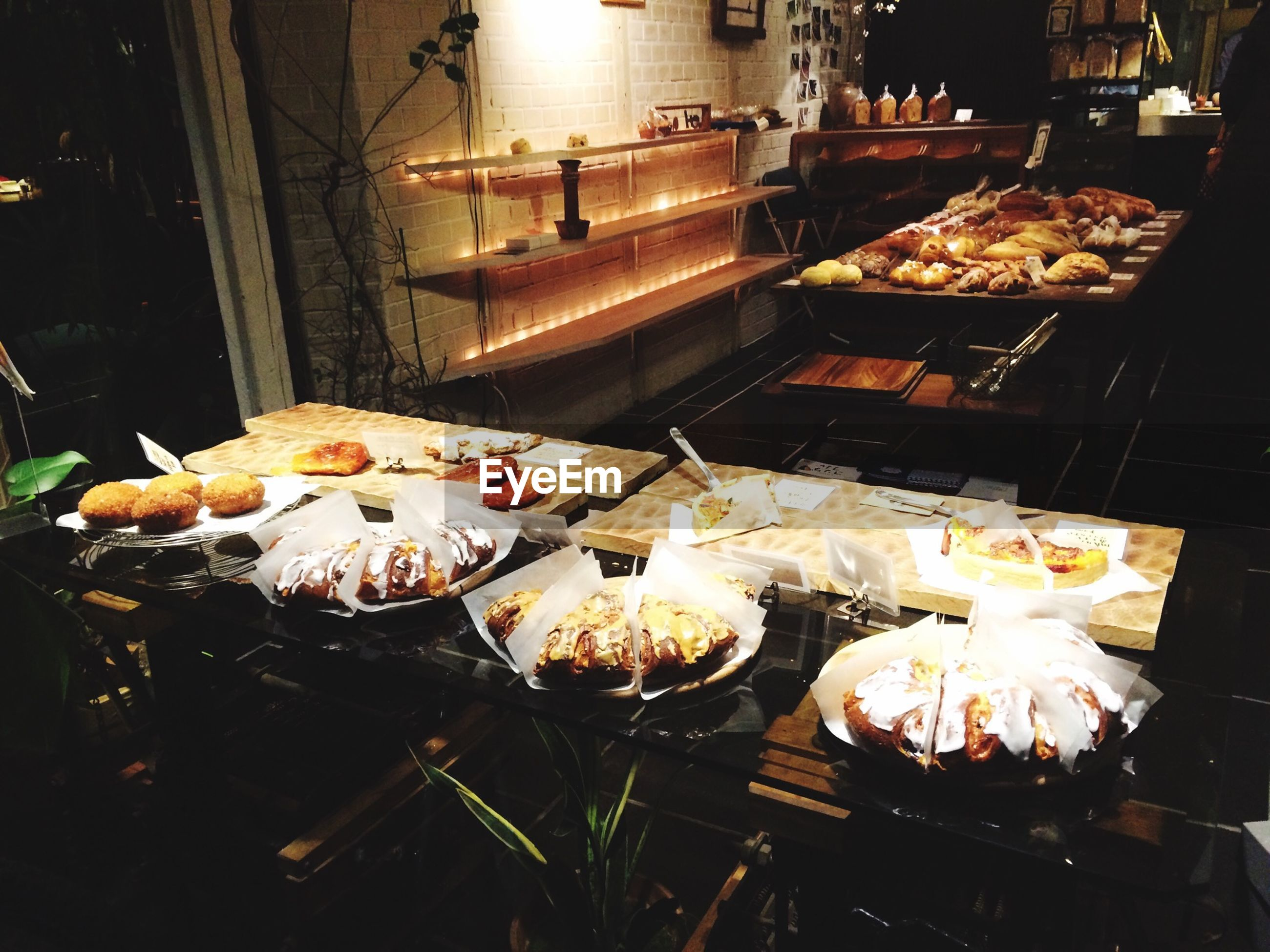 night, illuminated, indoors, fire - natural phenomenon, food and drink, flame, burning, food, freshness, heat - temperature, table, restaurant, preparation, glowing, cooking, candle, food and drink industry, high angle view, lit, no people
