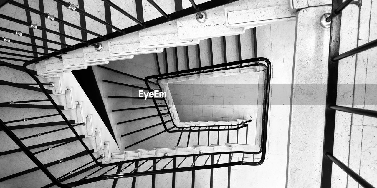 staircase, steps and staircases, railing, architecture, built structure, spiral, spiral staircase, metal, no people, indoors, pattern, day, directly above, repetition, low angle view, design, absence, diminishing perspective, safety, directly below