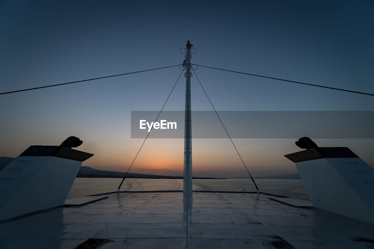 Silhouette Ship On Sea Against Clear Sky During Sunset