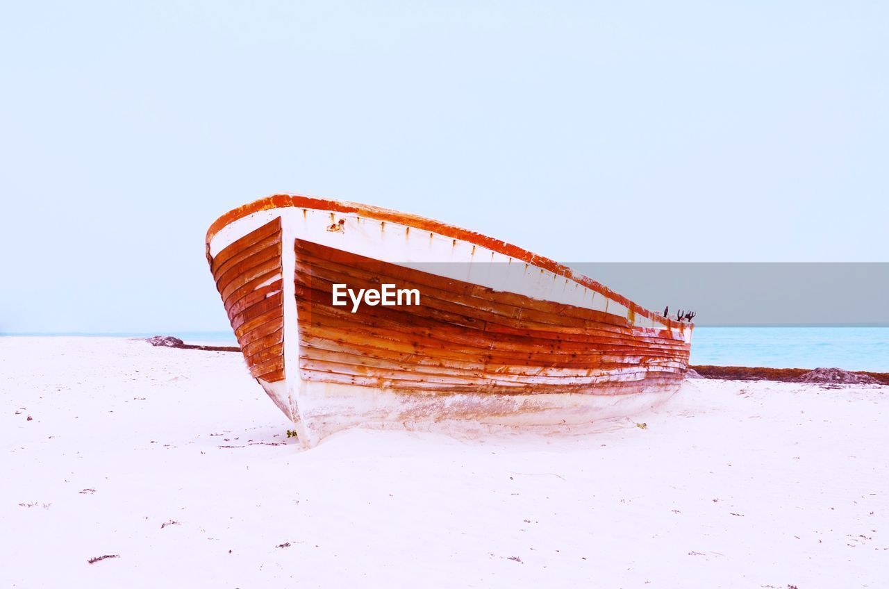 sea, copy space, nautical vessel, sky, land, clear sky, beach, water, transportation, abandoned, horizon, mode of transportation, horizon over water, no people, nature, day, sand, tranquility, damaged