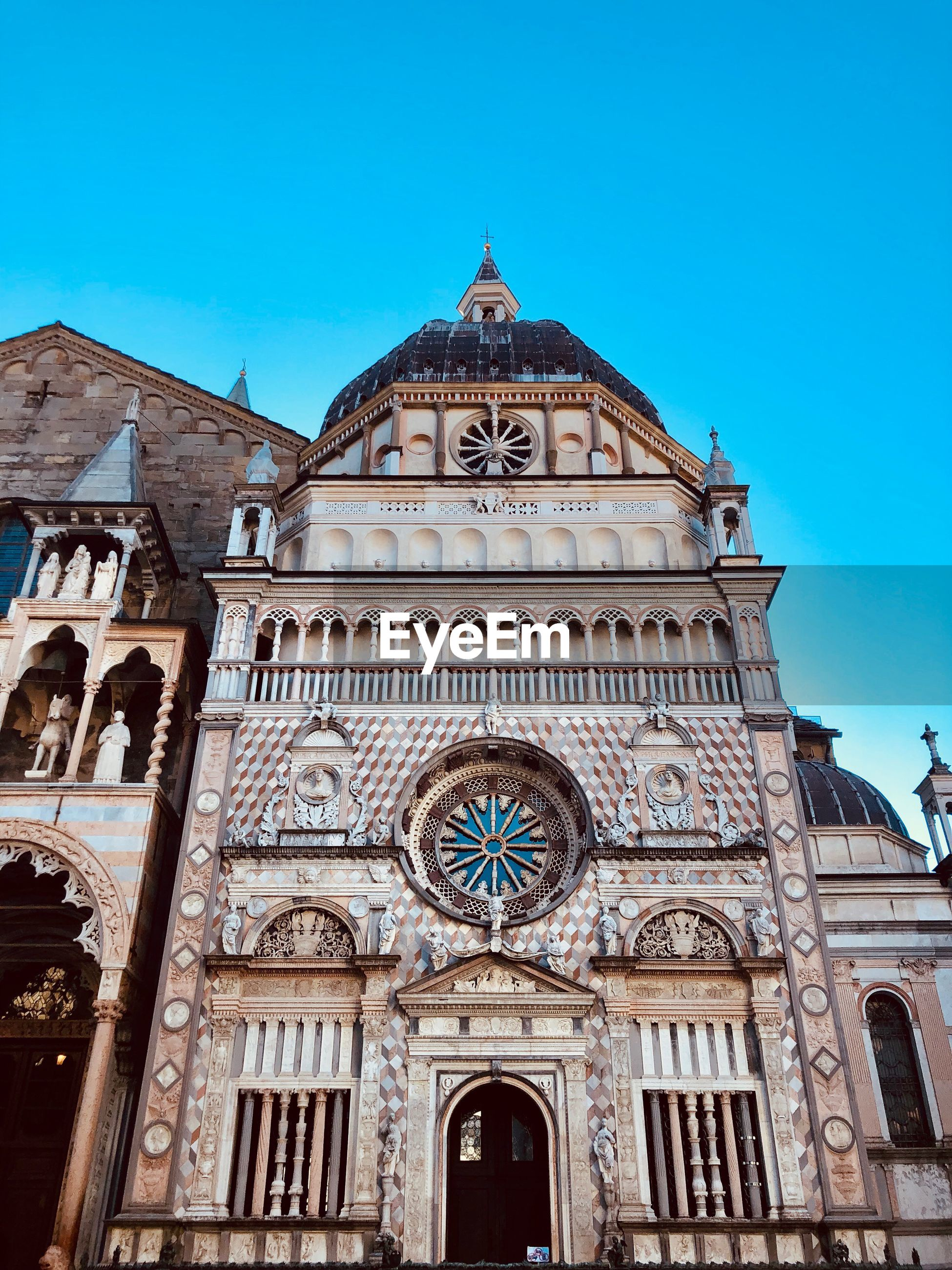 built structure, architecture, building exterior, sky, low angle view, building, place of worship, religion, blue, belief, spirituality, travel destinations, no people, nature, day, history, facade, clock, ornate