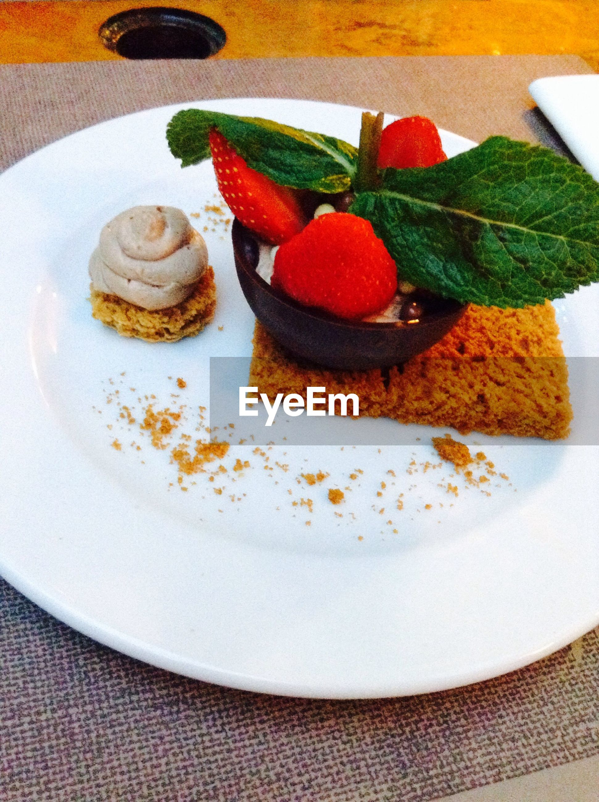 food and drink, food, indoors, freshness, plate, ready-to-eat, still life, sweet food, indulgence, table, serving size, dessert, high angle view, unhealthy eating, close-up, cake, temptation, meal, served