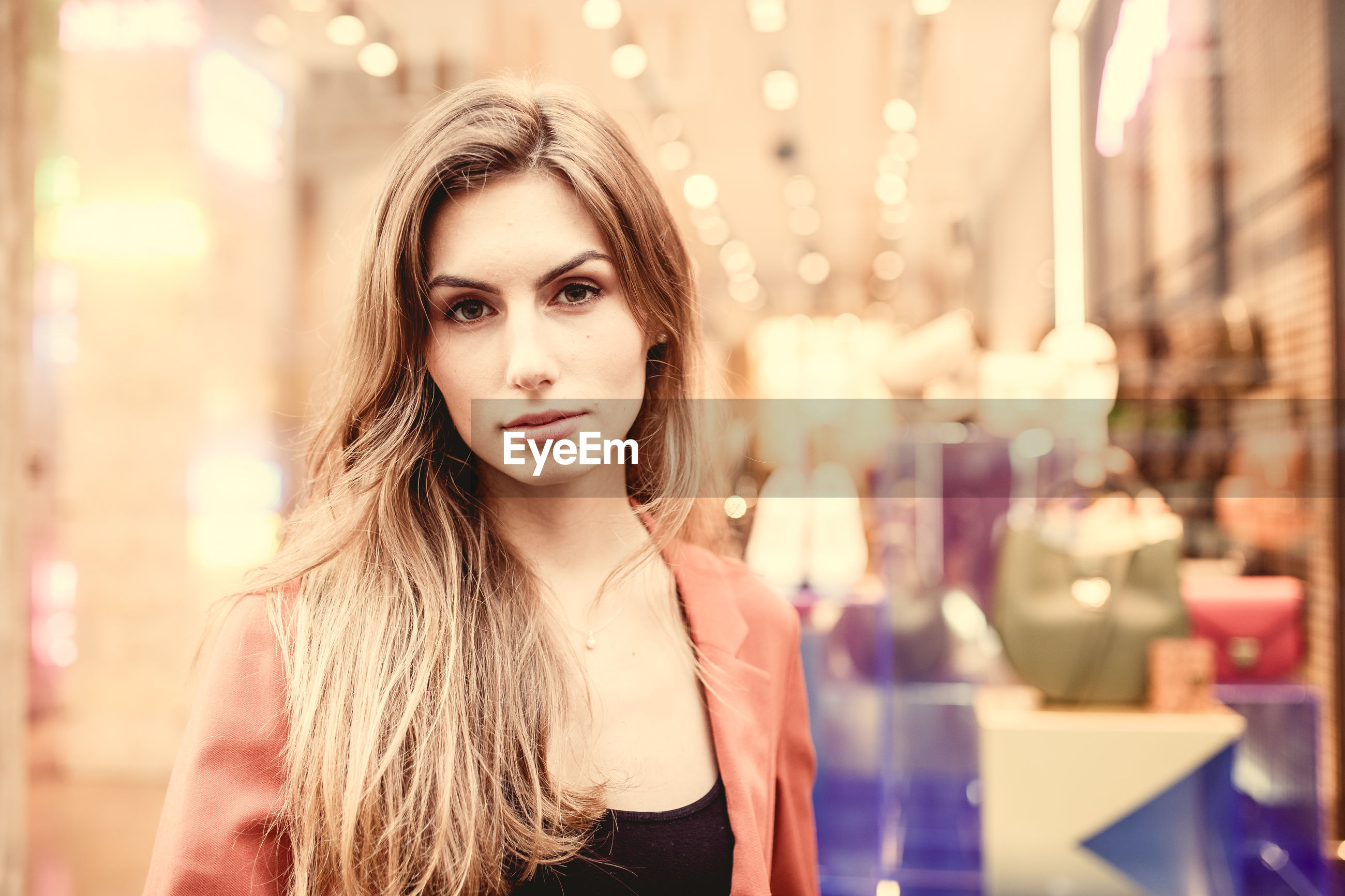 Portrait of beautiful woman standing in store