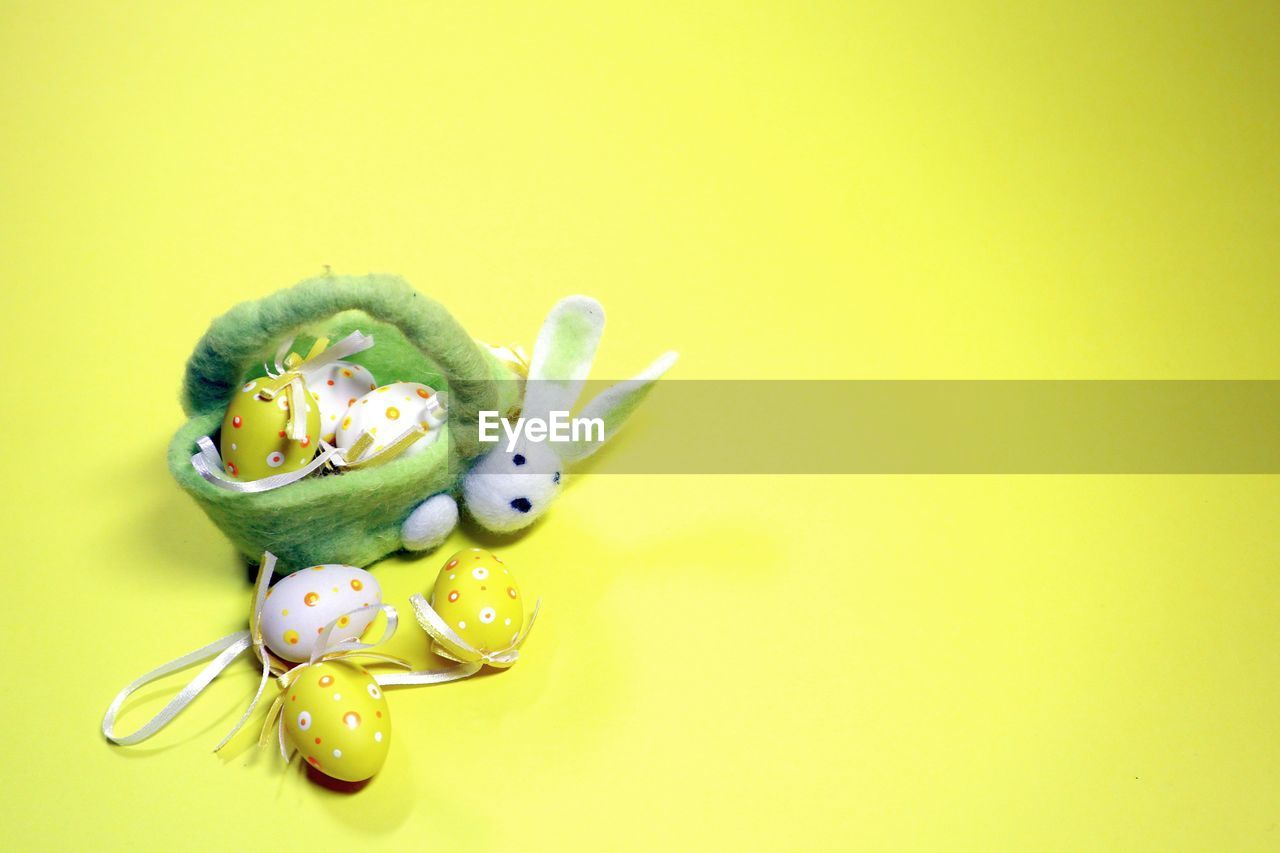 High angle view of easter eggs on yellow background