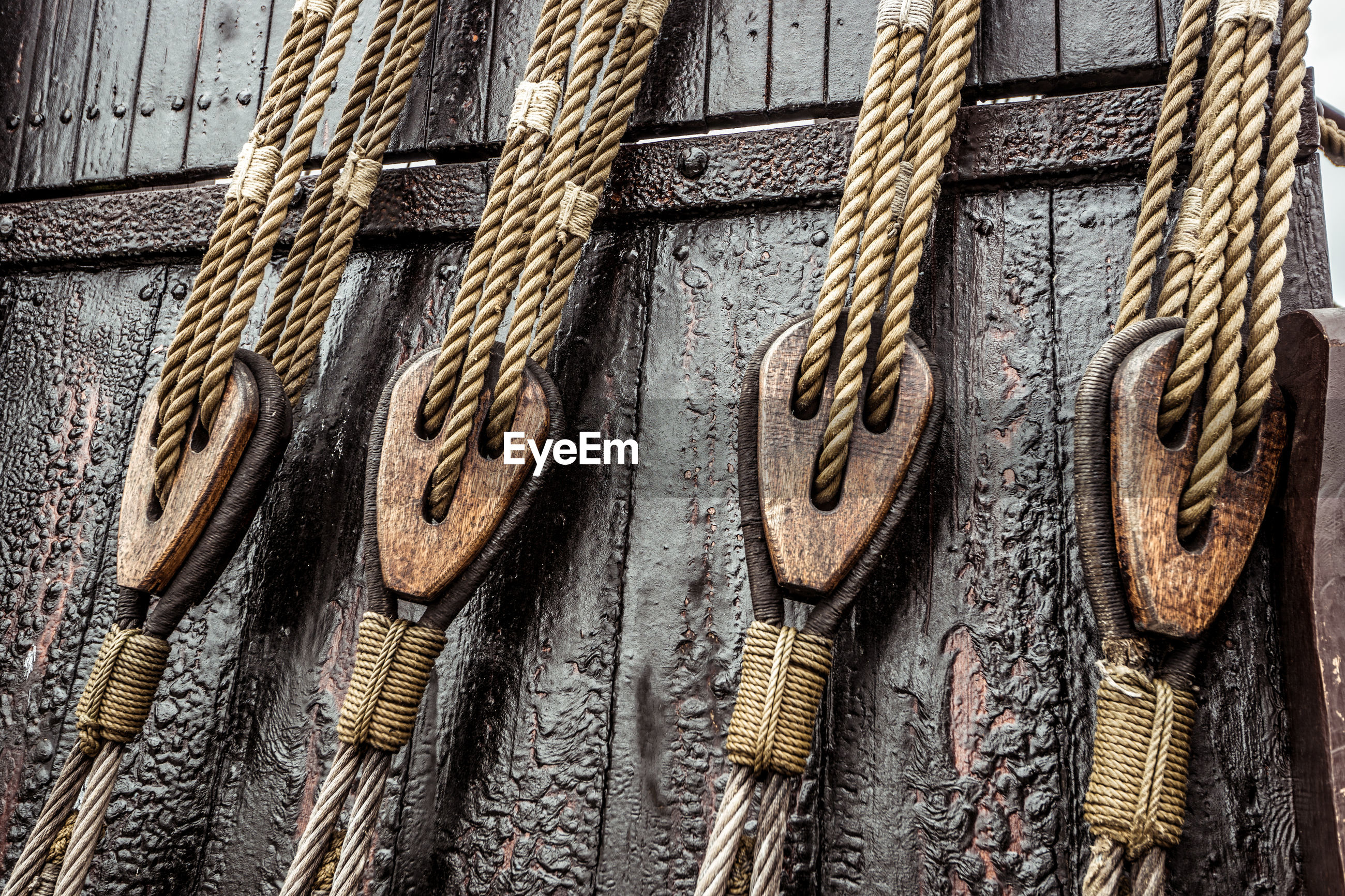 Low angle view of ropes hanging on boat