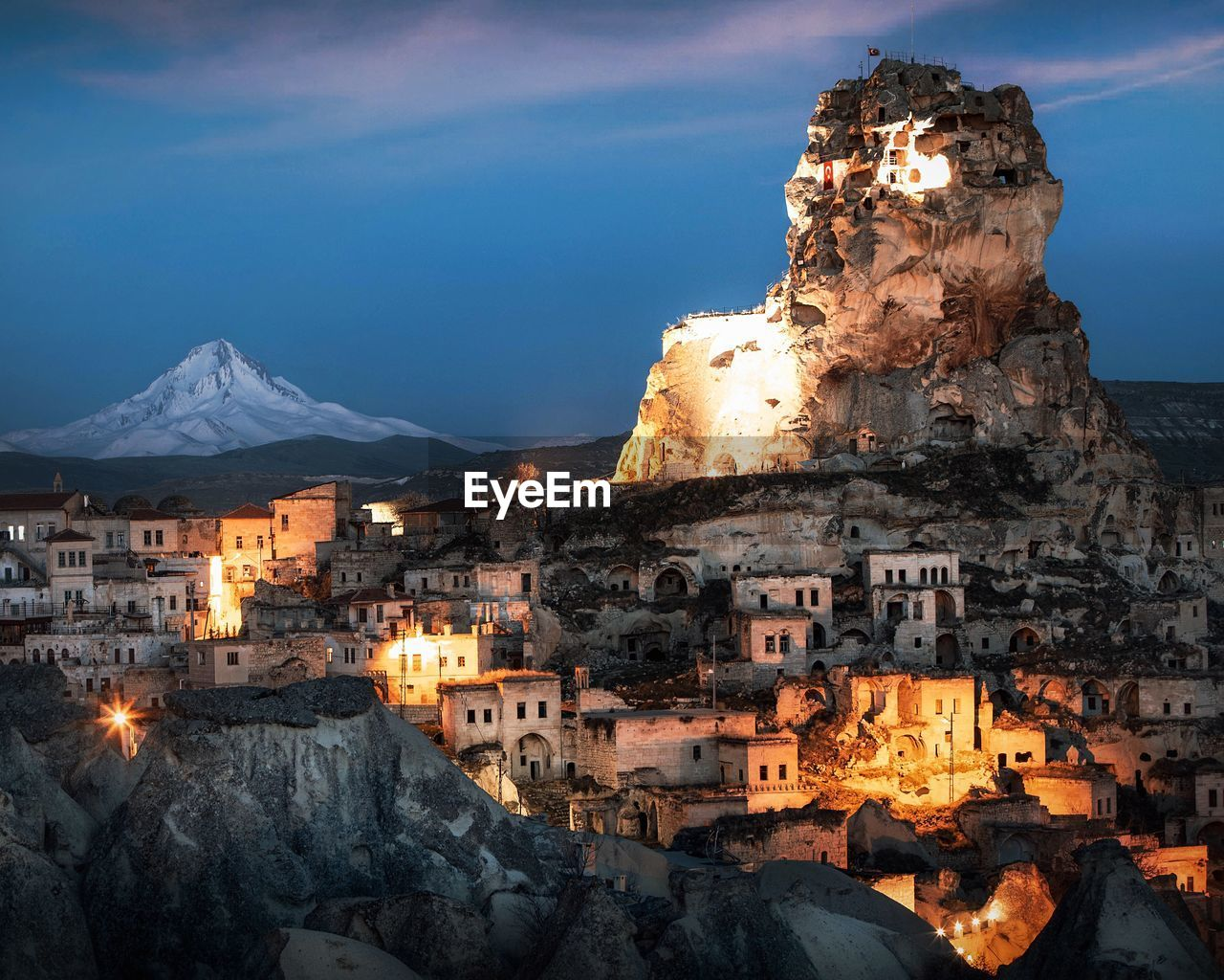 architecture, built structure, building exterior, building, sky, mountain, residential district, city, nature, tourism, travel destinations, travel, illuminated, no people, dusk, night, rock formation, town