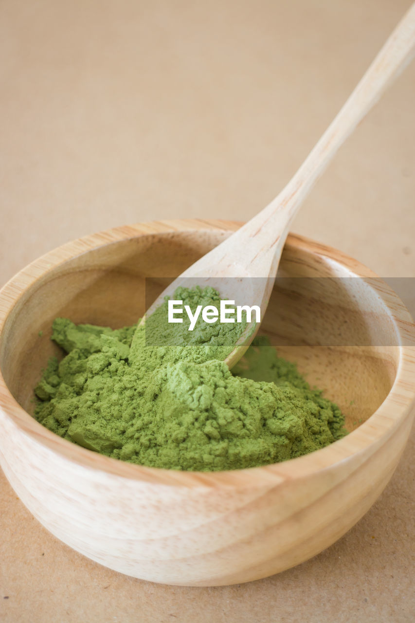 food and drink, spoon, kitchen utensil, bowl, food, freshness, green color, indoors, close-up, wood - material, no people, eating utensil, matcha tea, studio shot, healthy eating, wooden spoon, still life, tea, high angle view
