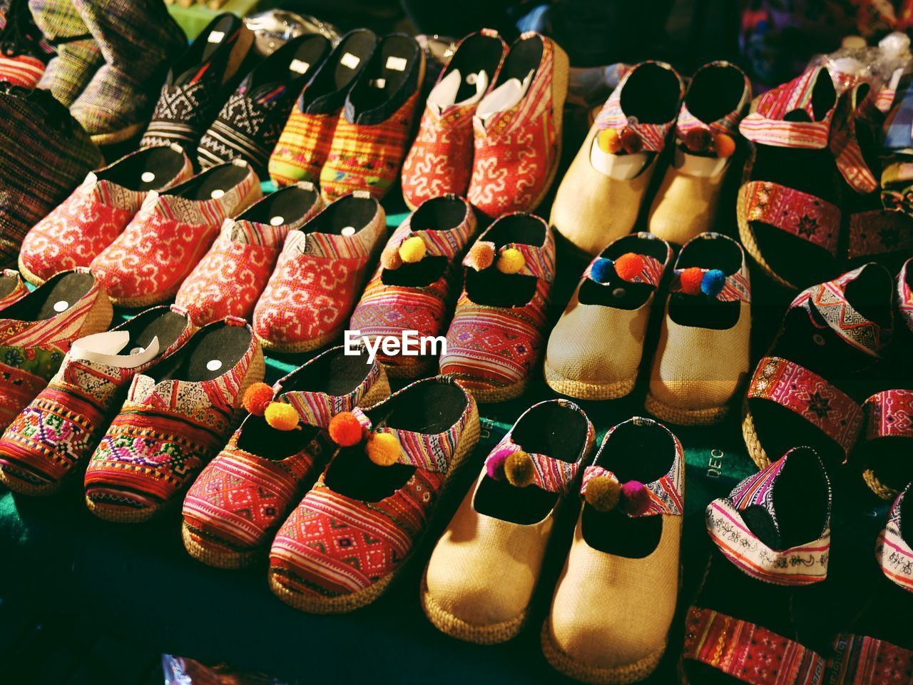 High angle view of footwear arranged at market stall