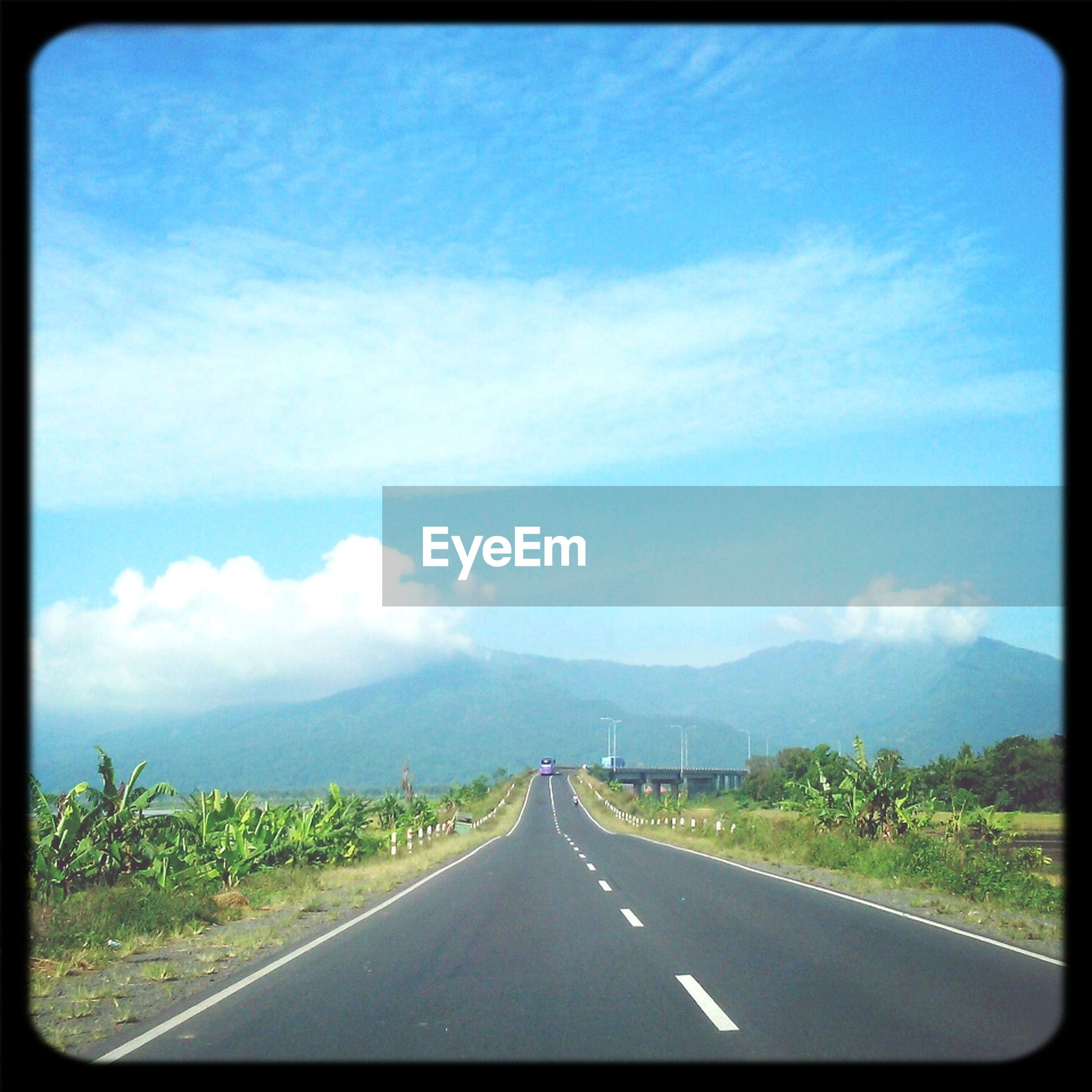 the way forward, road, transportation, road marking, transfer print, sky, diminishing perspective, vanishing point, mountain, country road, cloud - sky, landscape, cloud, auto post production filter, empty, tranquil scene, tranquility, scenics, nature, highway