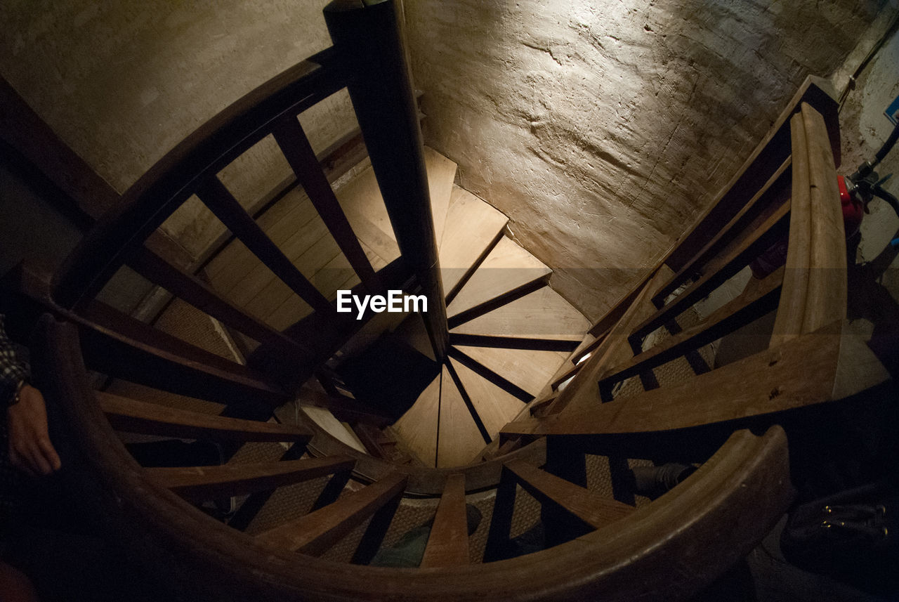 staircase, steps and staircases, steps, railing, spiral stairs, indoors, architecture, high angle view, spiral, built structure, stairs, wood - material, no people, spiral staircase, day