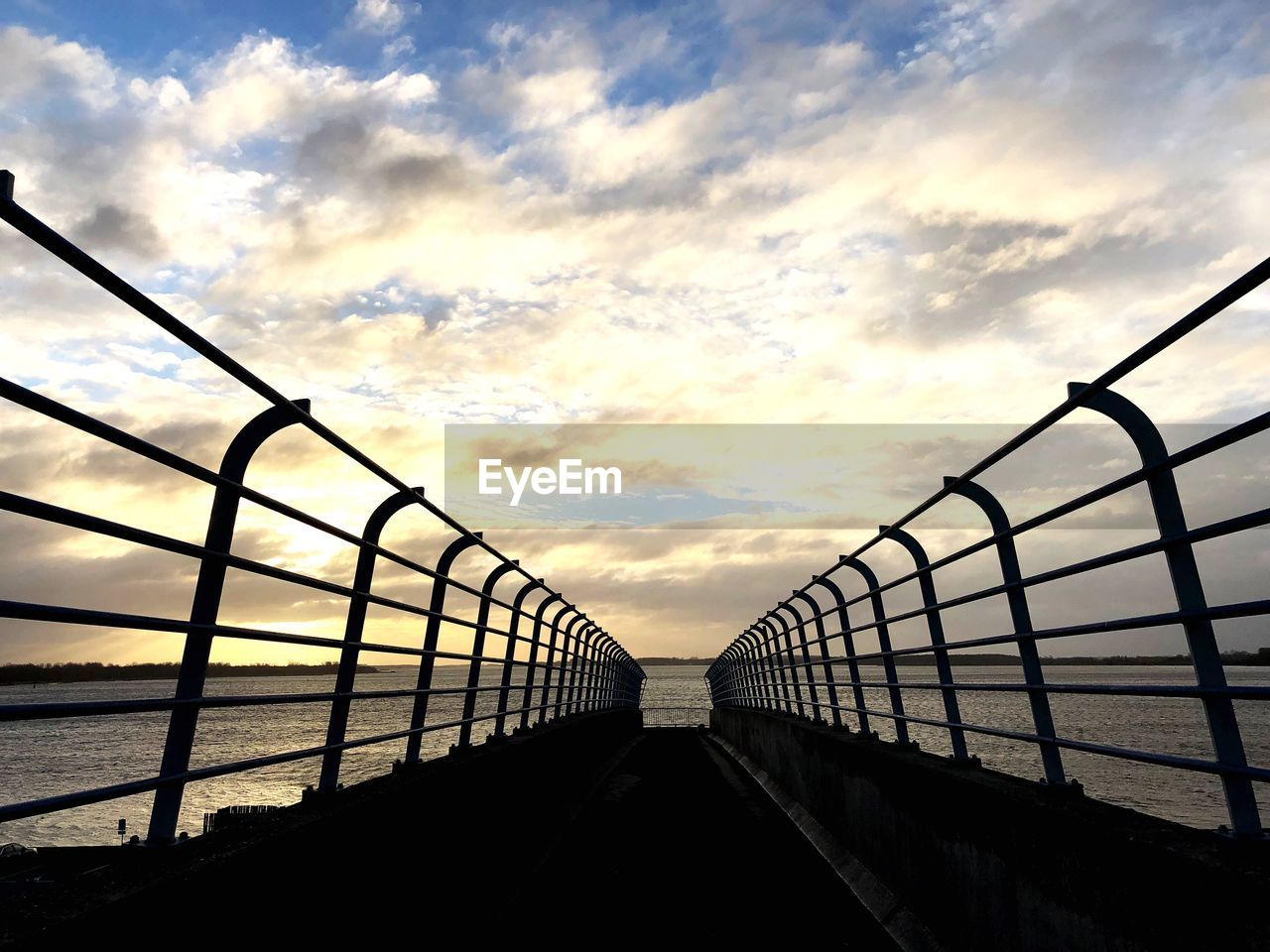 sky, cloud - sky, sunset, railing, nature, architecture, no people, built structure, beauty in nature, metal, water, sea, outdoors, bridge, scenics - nature, silhouette, connection, low angle view, orange color