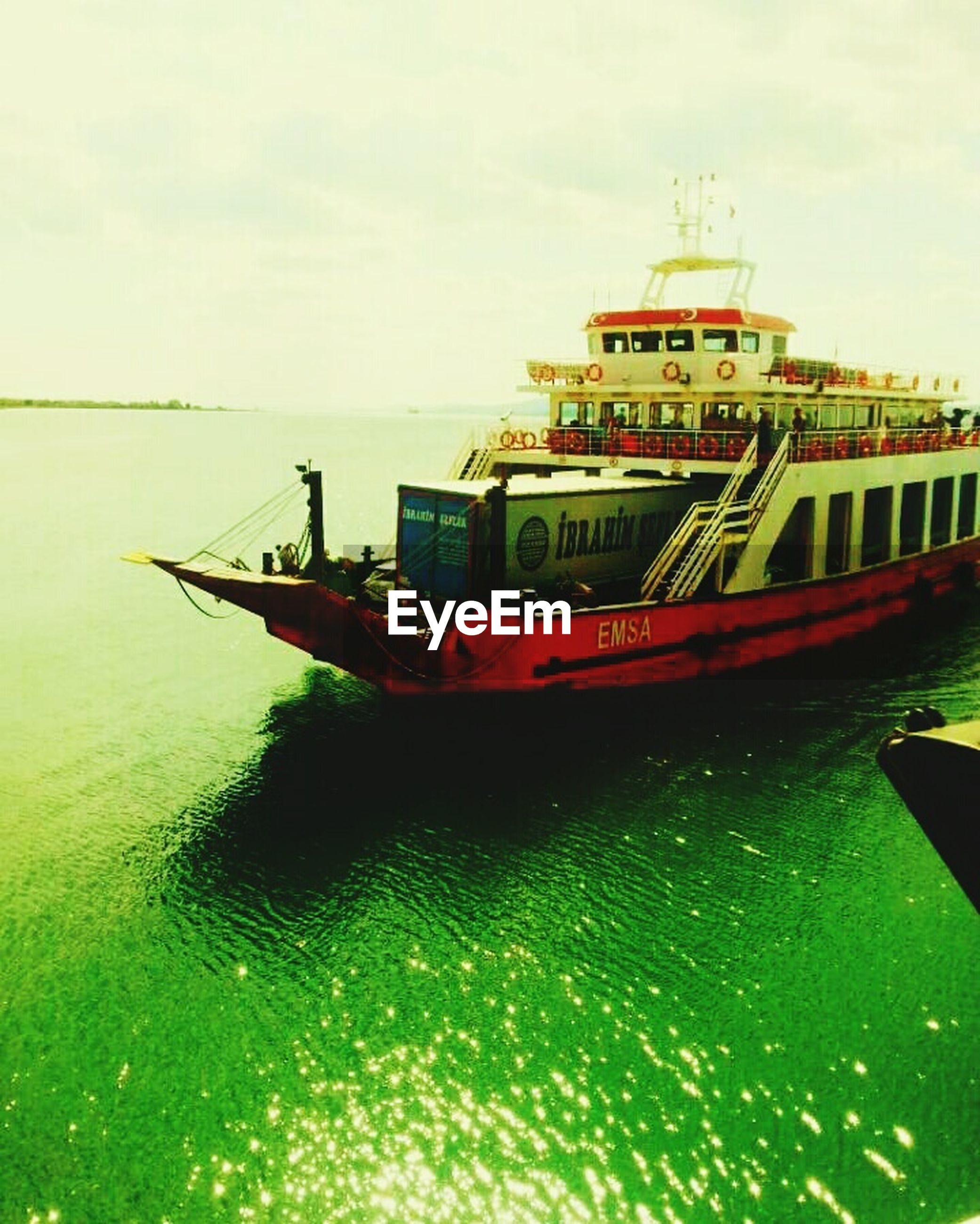 water, nautical vessel, sea, sky, waterfront, outdoors, no people, ferry, nature, tourboat, day