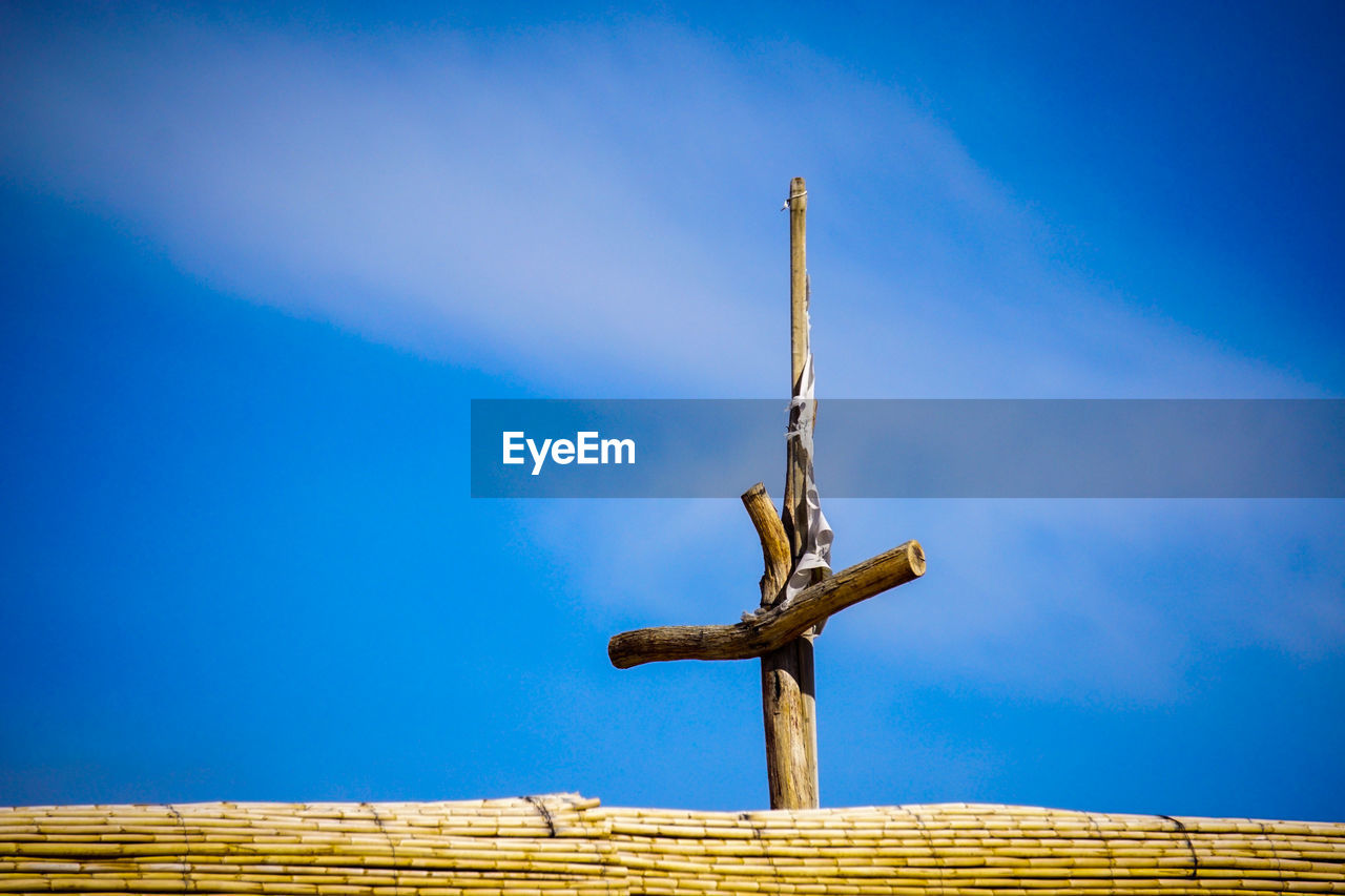 sky, blue, low angle view, nature, cloud - sky, day, no people, wood - material, metal, outdoors, vapor trail, sunlight, built structure, rusty, architecture, industry, old, wood, high section, smoke - physical structure