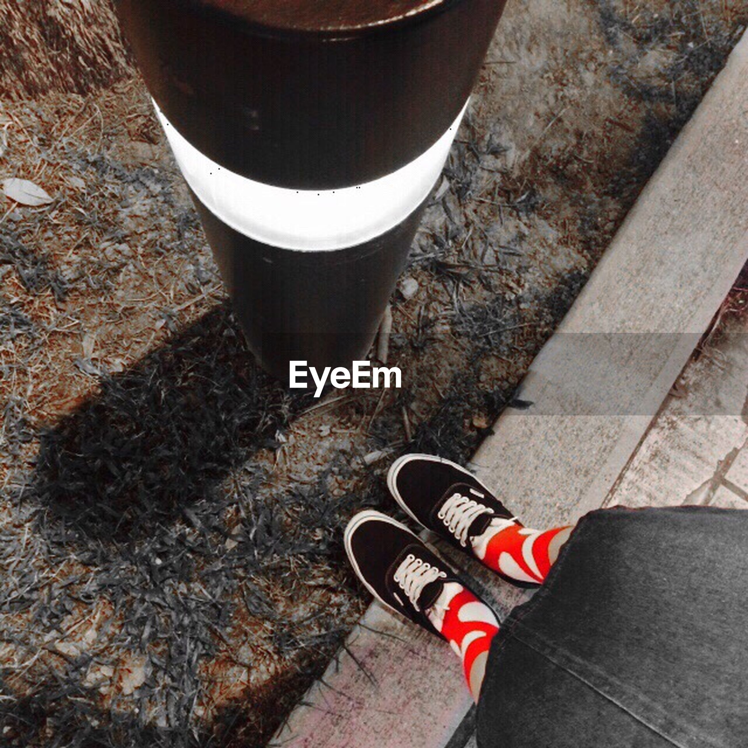 high angle view, shoe, still life, food and drink, drink, close-up, coffee cup, directly above, outdoors, red, day, low section, street, footwear, sunlight, elevated view, one person, table, coffee - drink