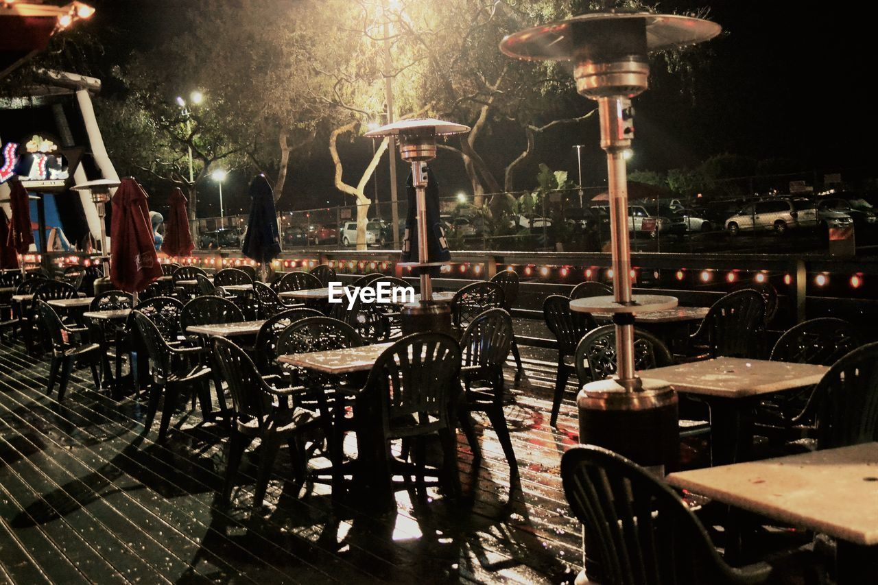 Empty Chairs And Tables In Cafe At Night