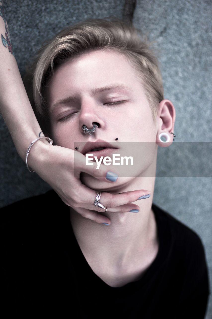 Conceptual portrait of young male fashion model
