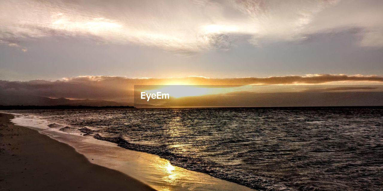 sea, water, sky, beauty in nature, sunset, beach, land, cloud - sky, scenics - nature, tranquility, tranquil scene, reflection, nature, sunlight, horizon, sun, idyllic, no people, motion, horizon over water, outdoors