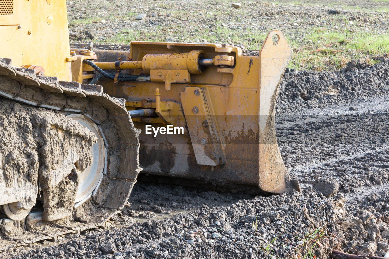 Close-up of excavator at construction site