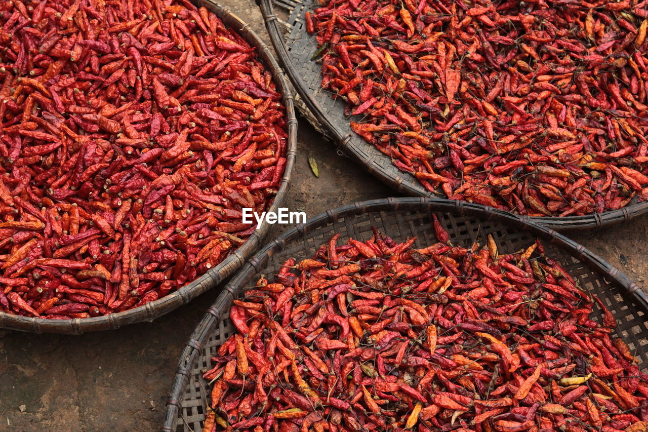High Angle View Of Dried Red Chili Peppers In Container