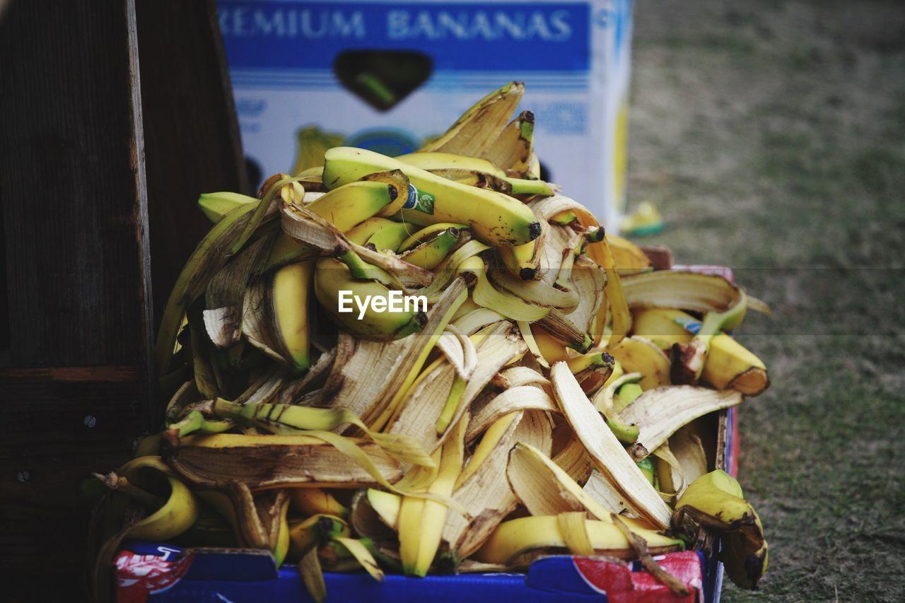 Close-up of banana peels heap in cardboard box