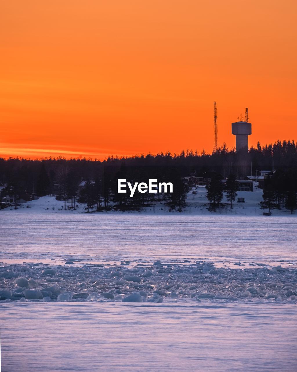SCENIC VIEW OF ORANGE SKY DURING WINTER