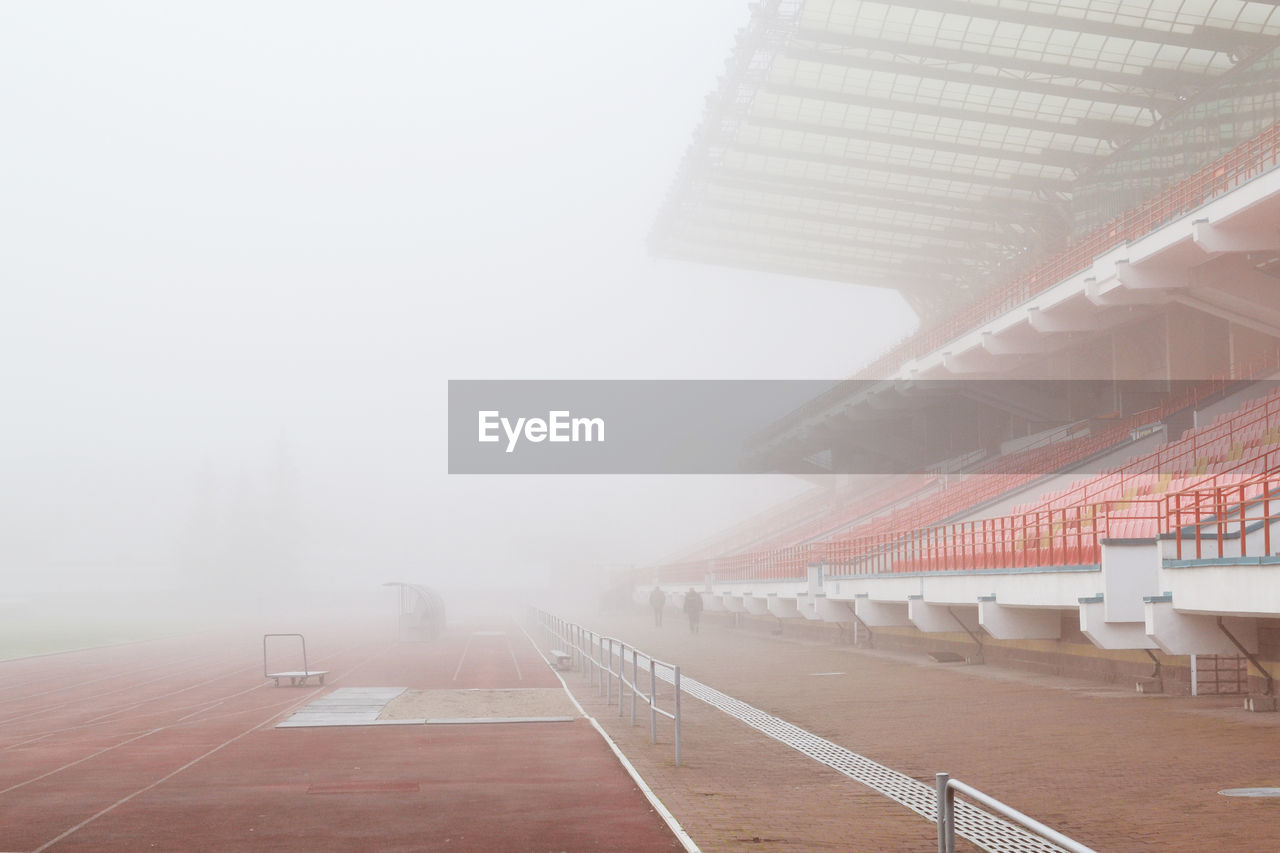 Empty Stadium And Playing Field During Foggy Weather