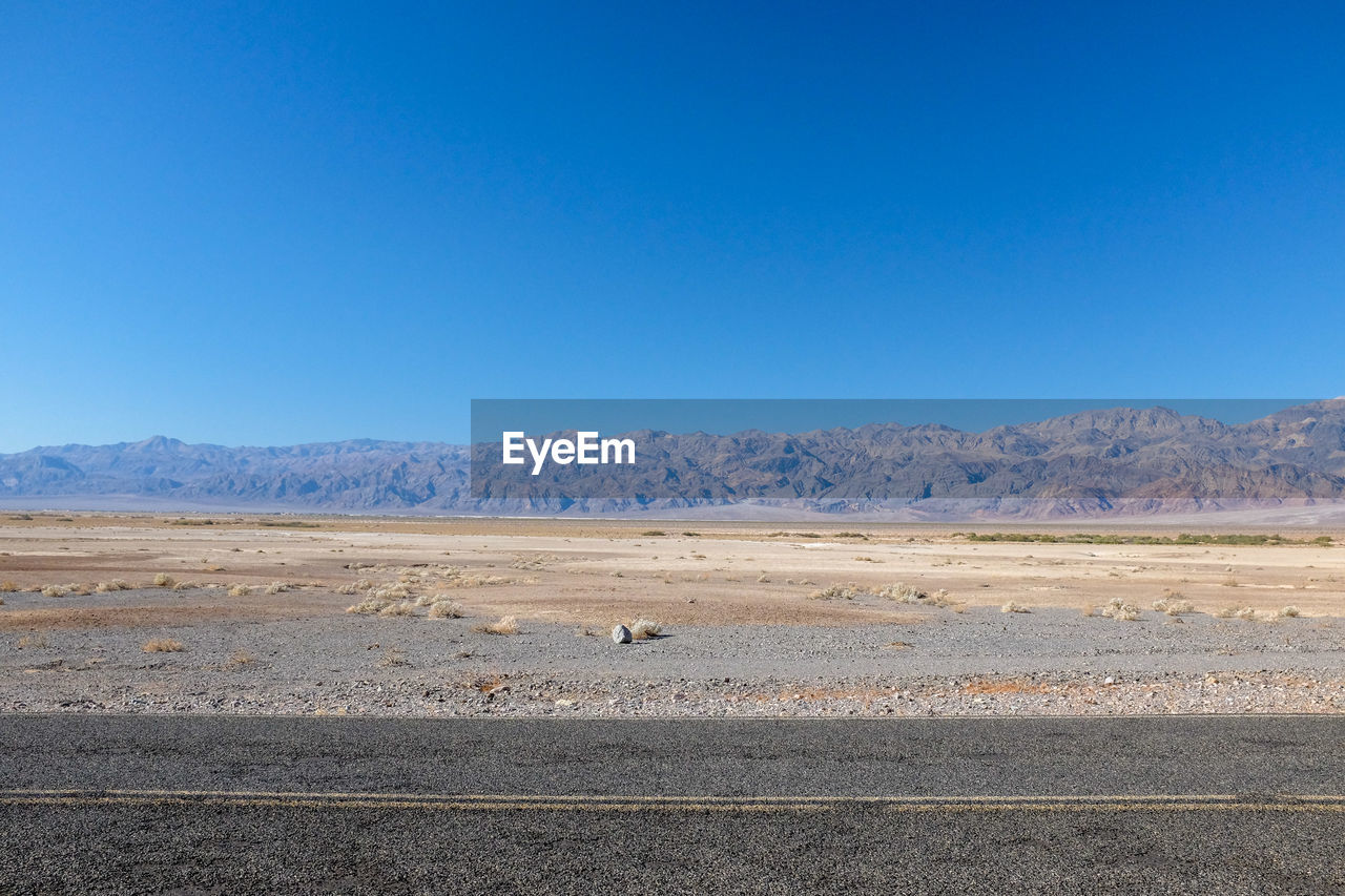 sky, blue, environment, copy space, clear sky, scenics - nature, landscape, beauty in nature, tranquil scene, tranquility, mountain, nature, no people, non-urban scene, day, road, land, animal, transportation, animal themes, arid climate, outdoors, climate