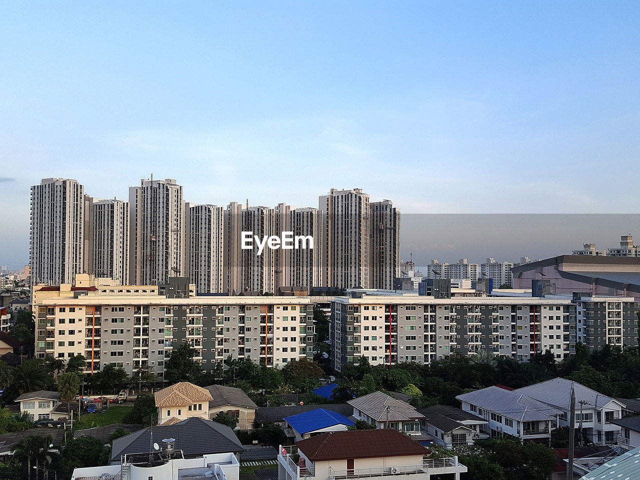 building exterior, architecture, built structure, city, sky, building, residential district, day, nature, cityscape, no people, office building exterior, tree, mode of transportation, tall - high, outdoors, urban skyline, plant, high angle view, landscape, skyscraper, apartment, settlement