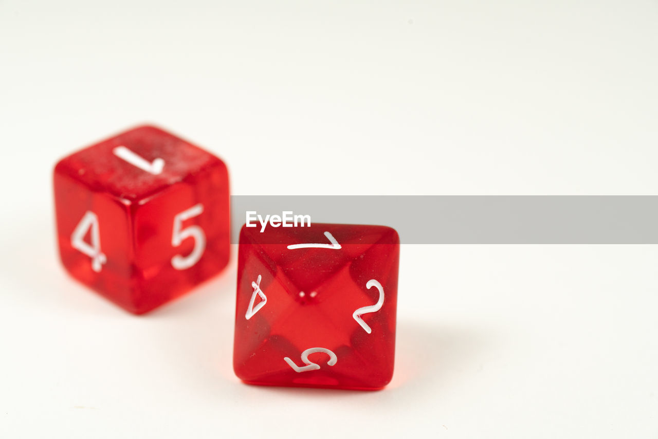 Close-up of red dices on white background