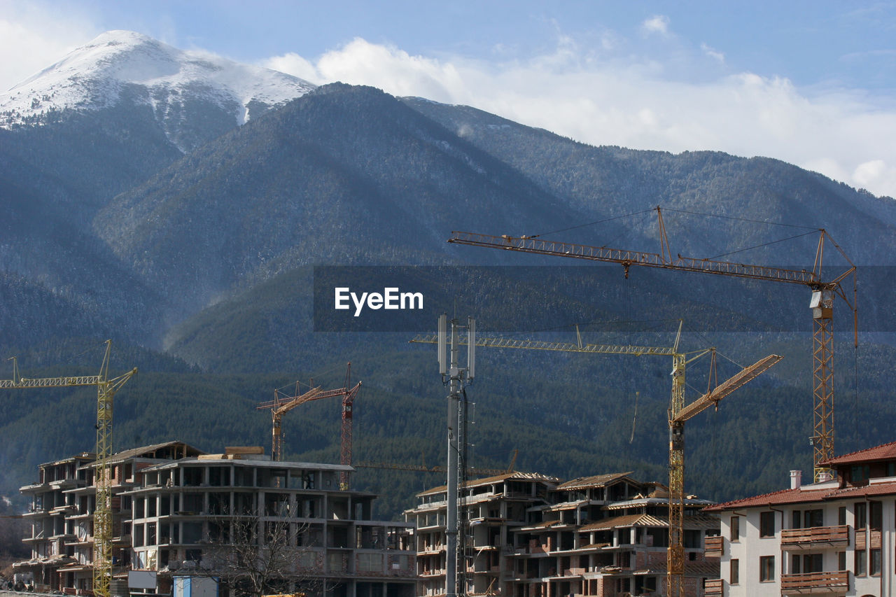 Construction Site By Mountains Against Sky